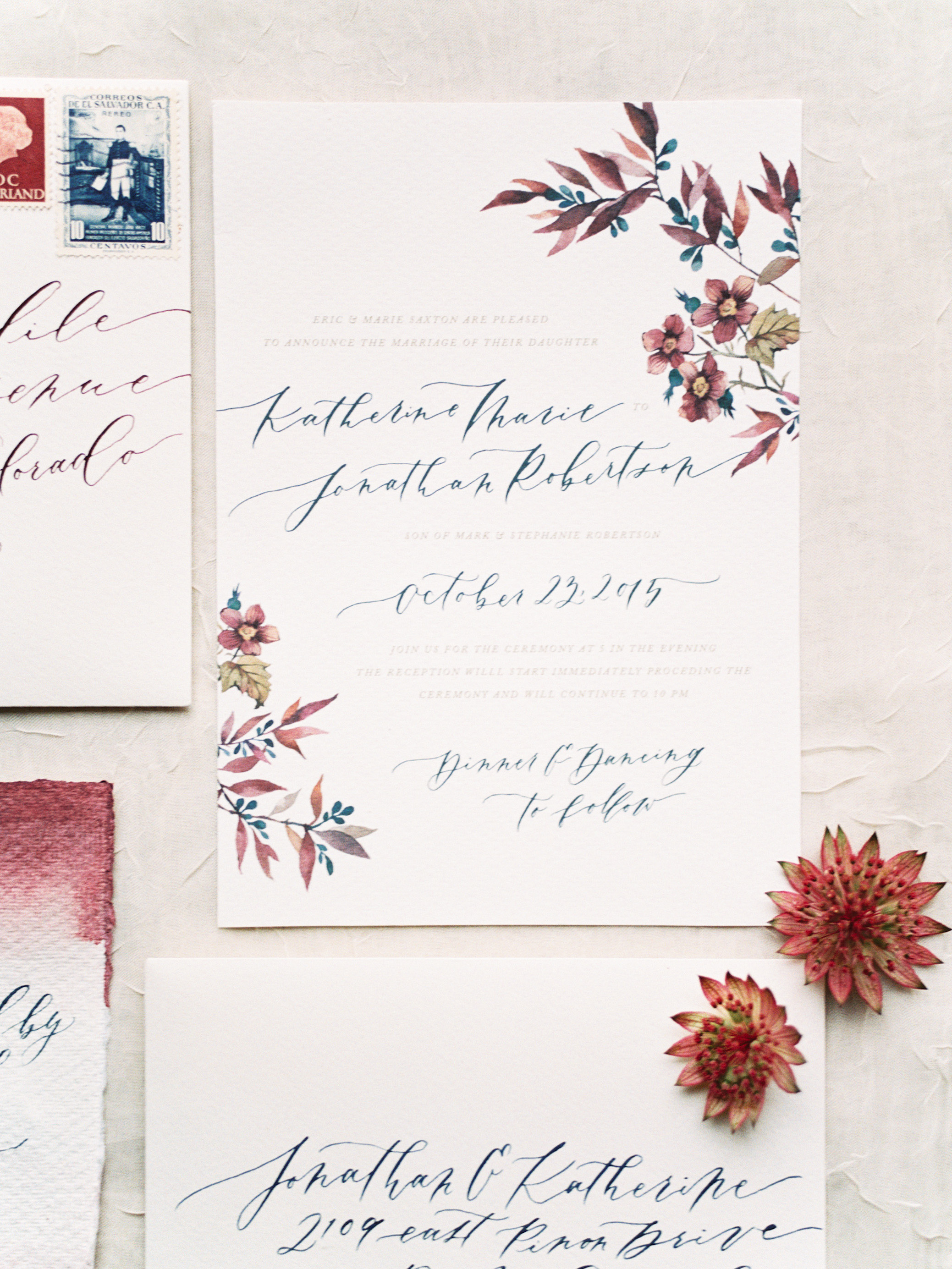 red, blue, white, and green watercolor wedding invitations
