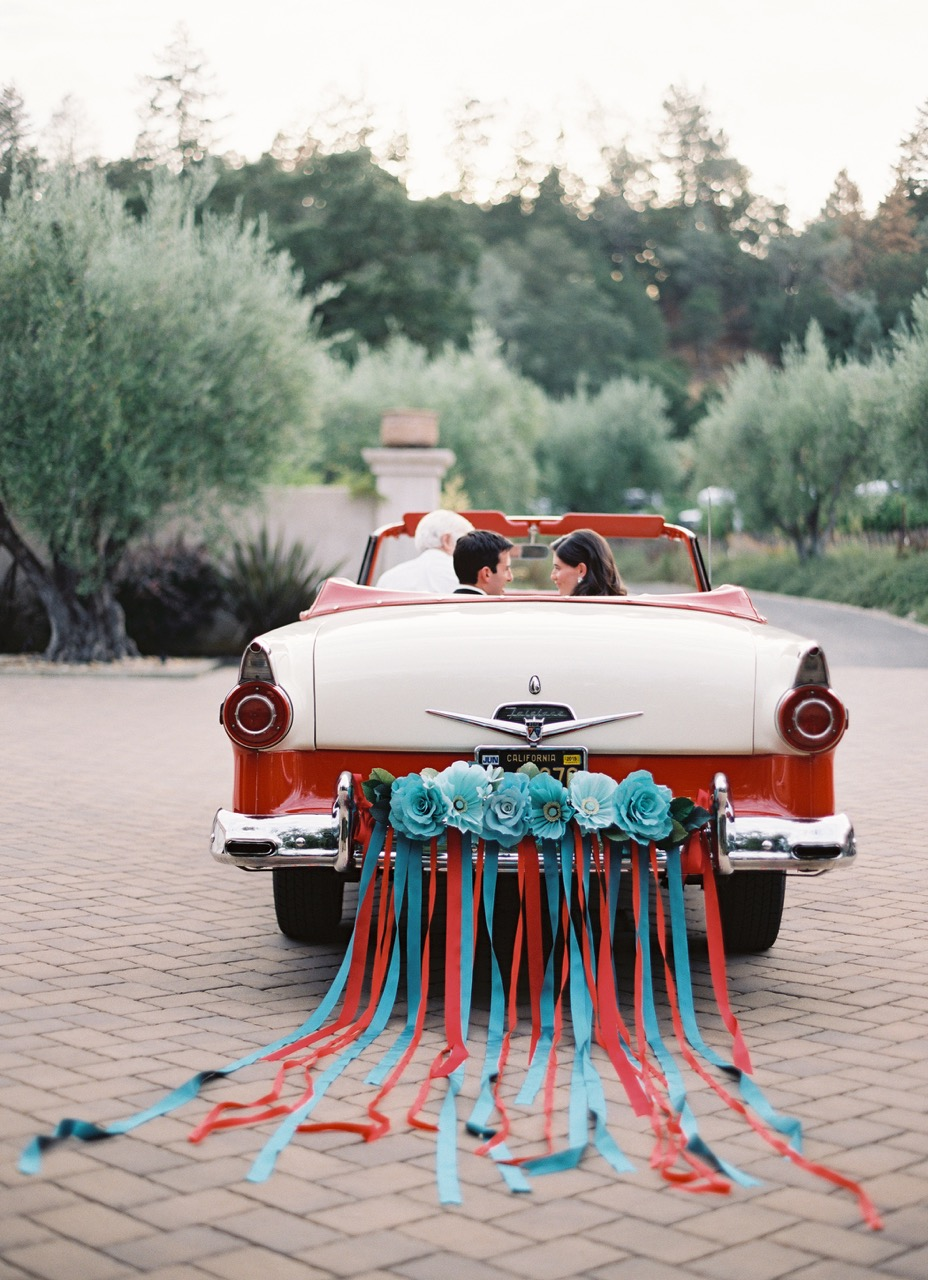 couple in decorated convertible
