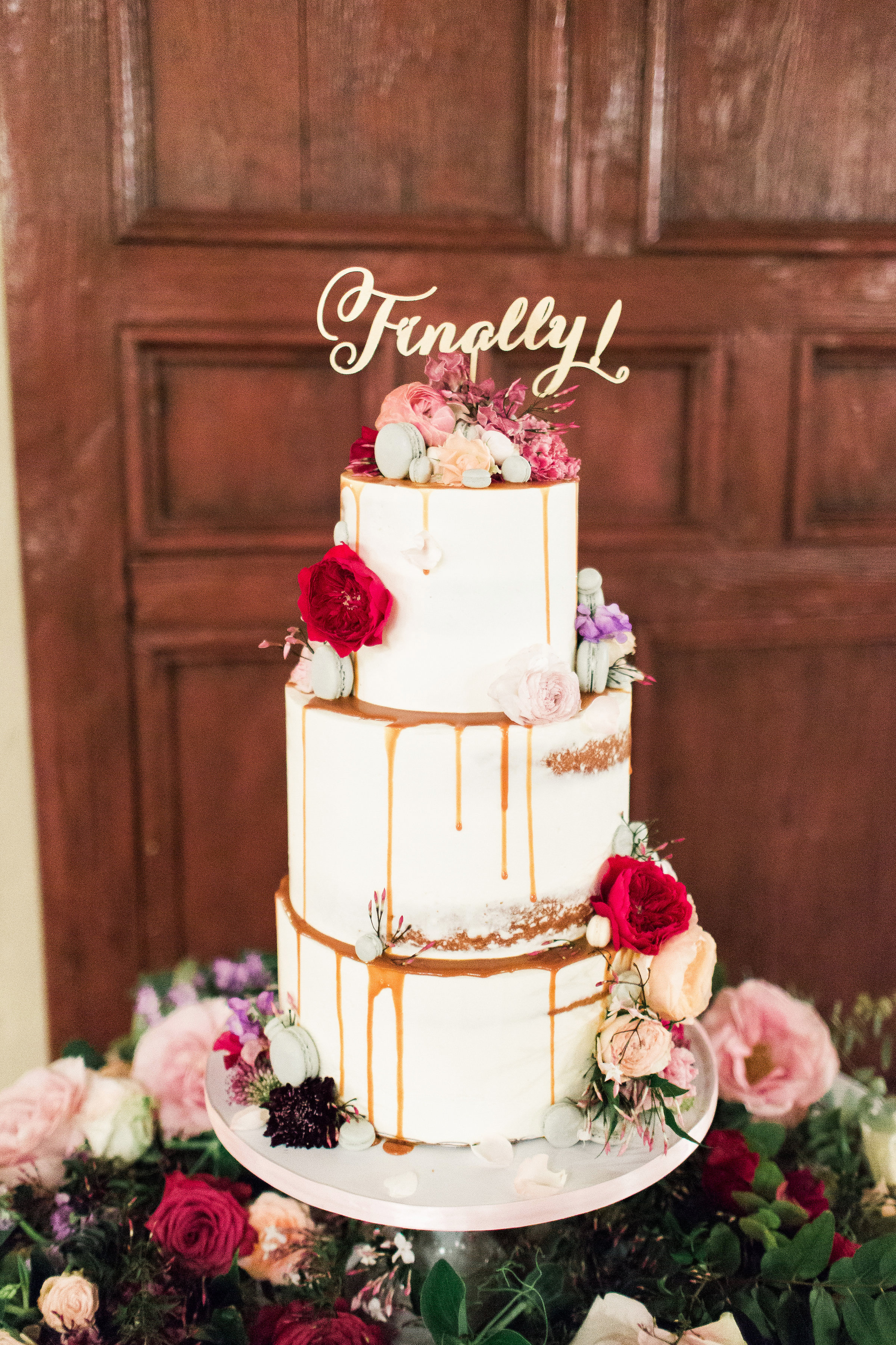 three tier white drip cake