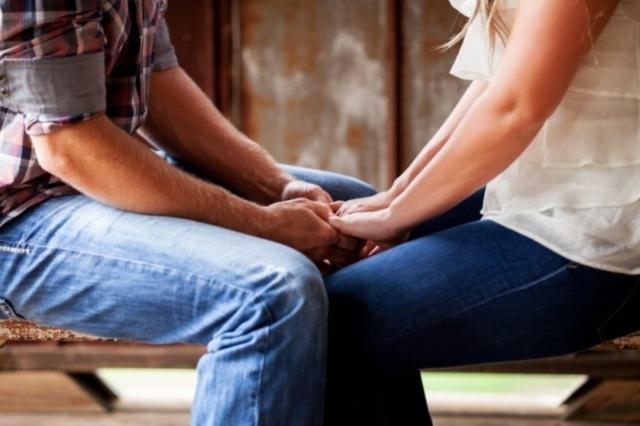 couple holding hands tough experiences