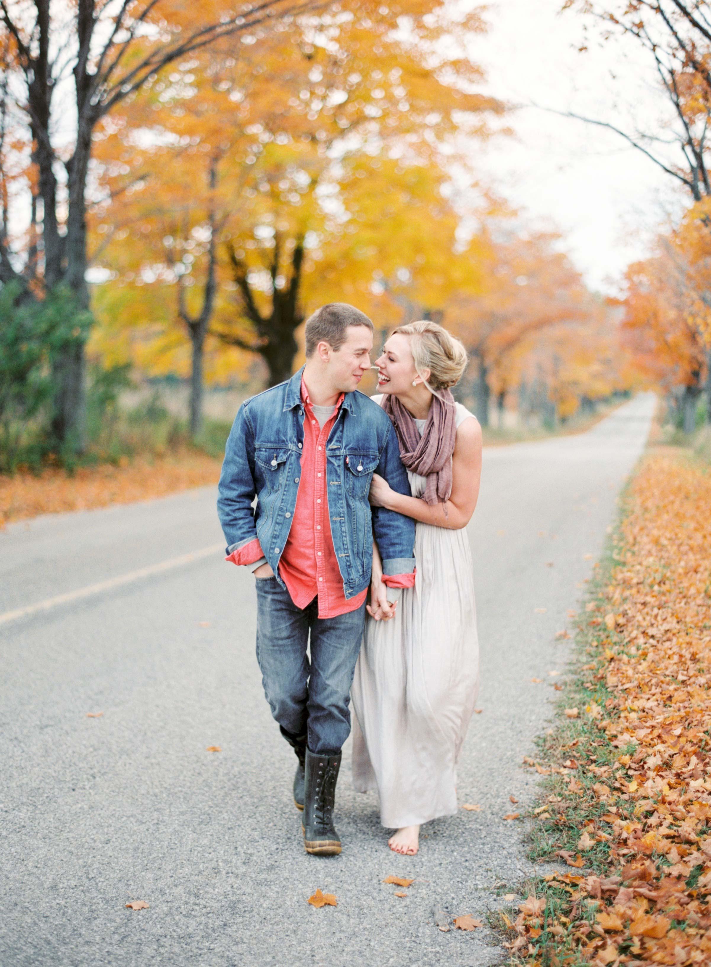 couple walking fall road