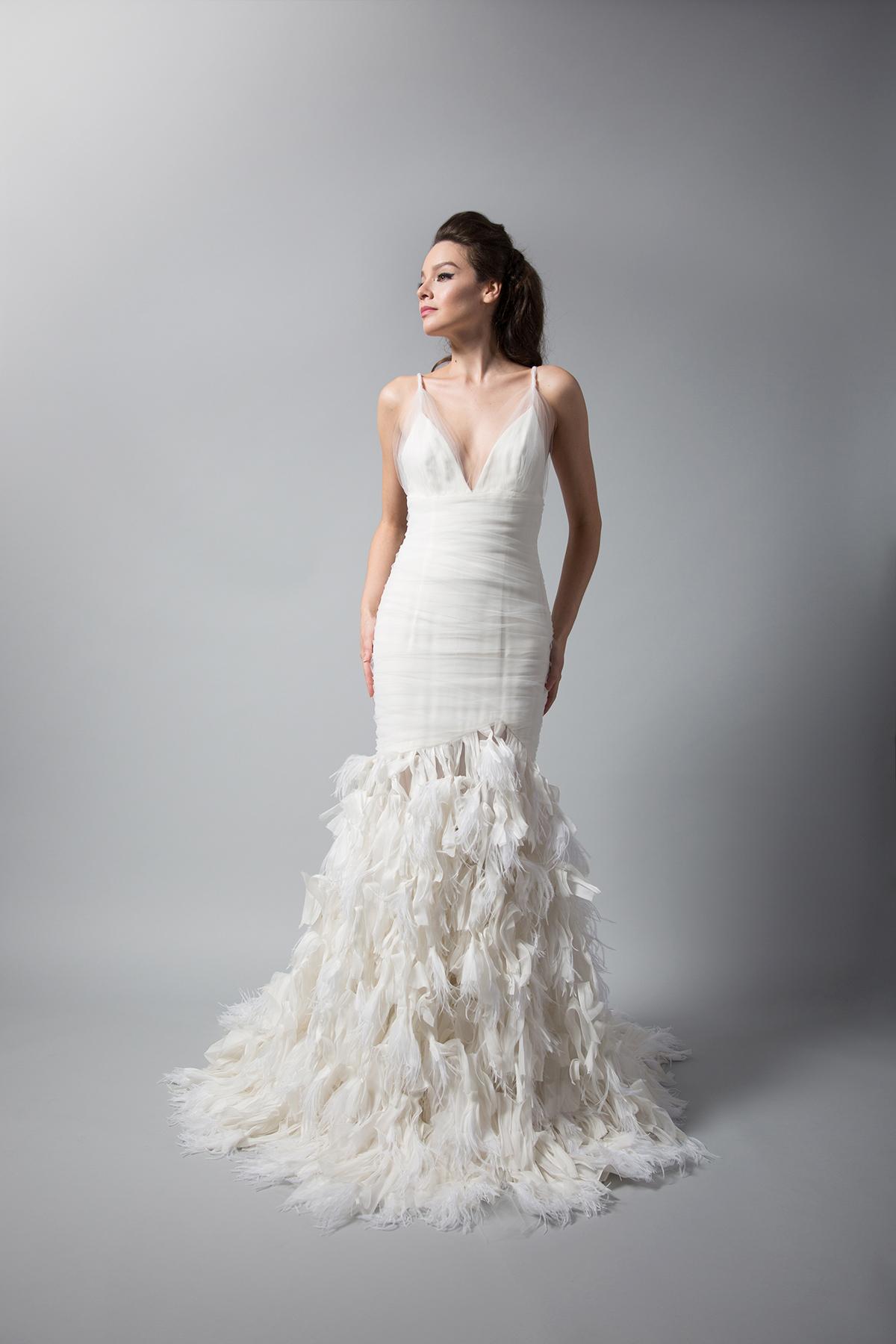 randi rahm trumpet wedding dress with spaghetti straps and feathers fall 2018