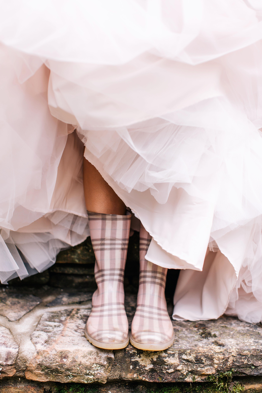 bride wearing rain boots