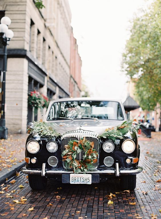 Fall Wreath and greenery draping black car