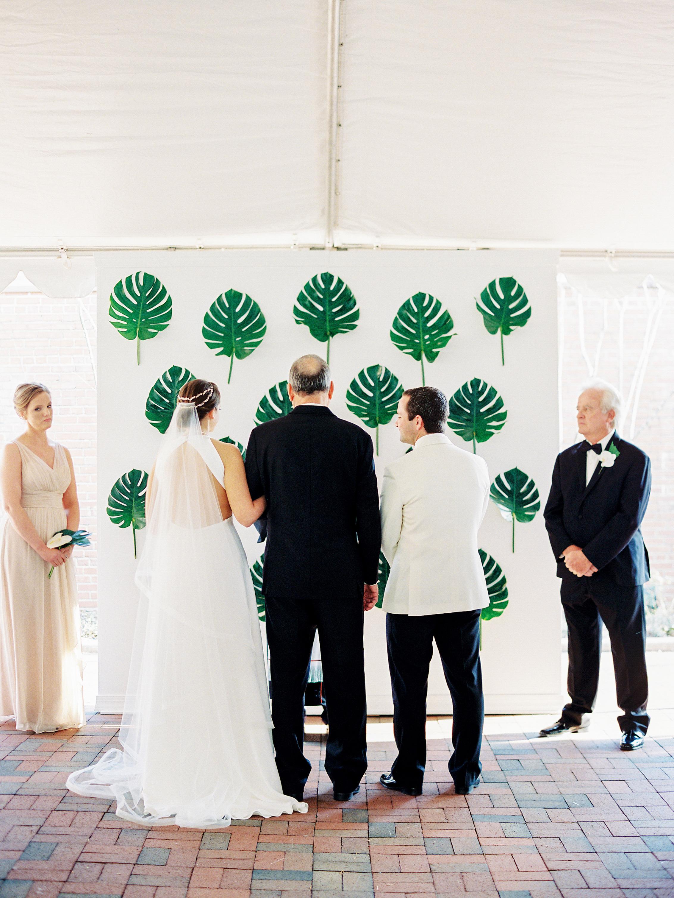 Green leaf on white wall altar
