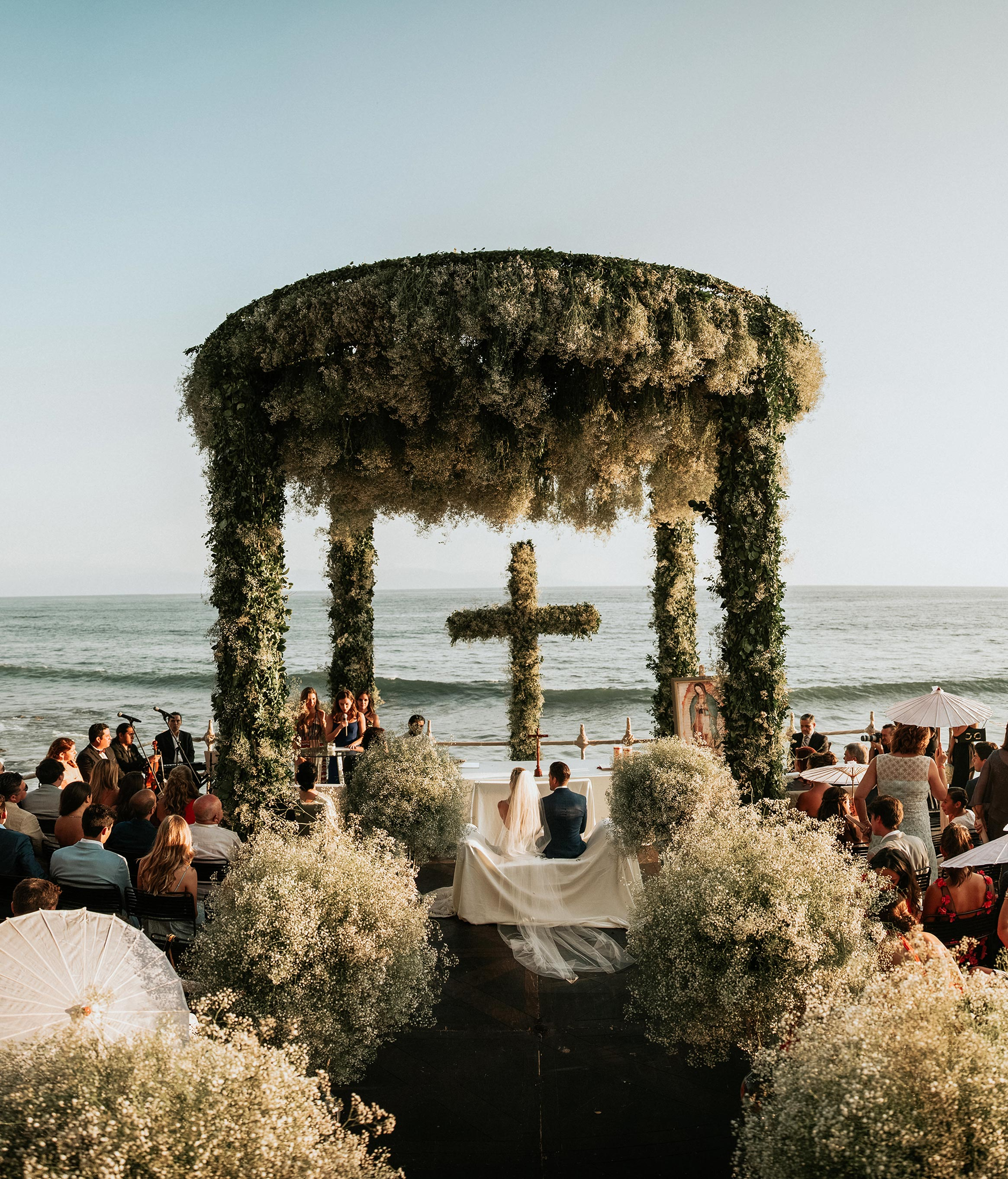beach wedding ceremony cross