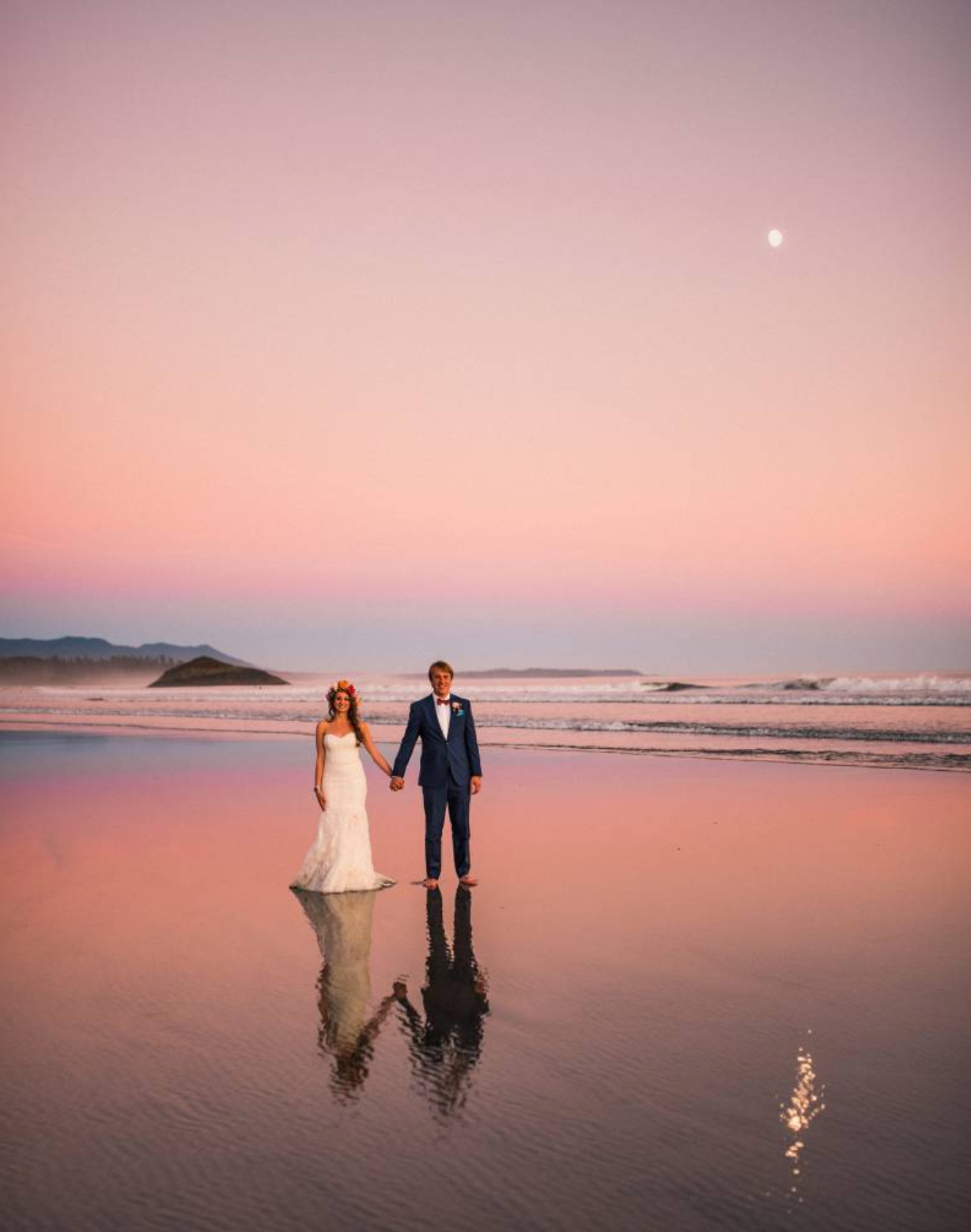 couple holding hand on beach sunset