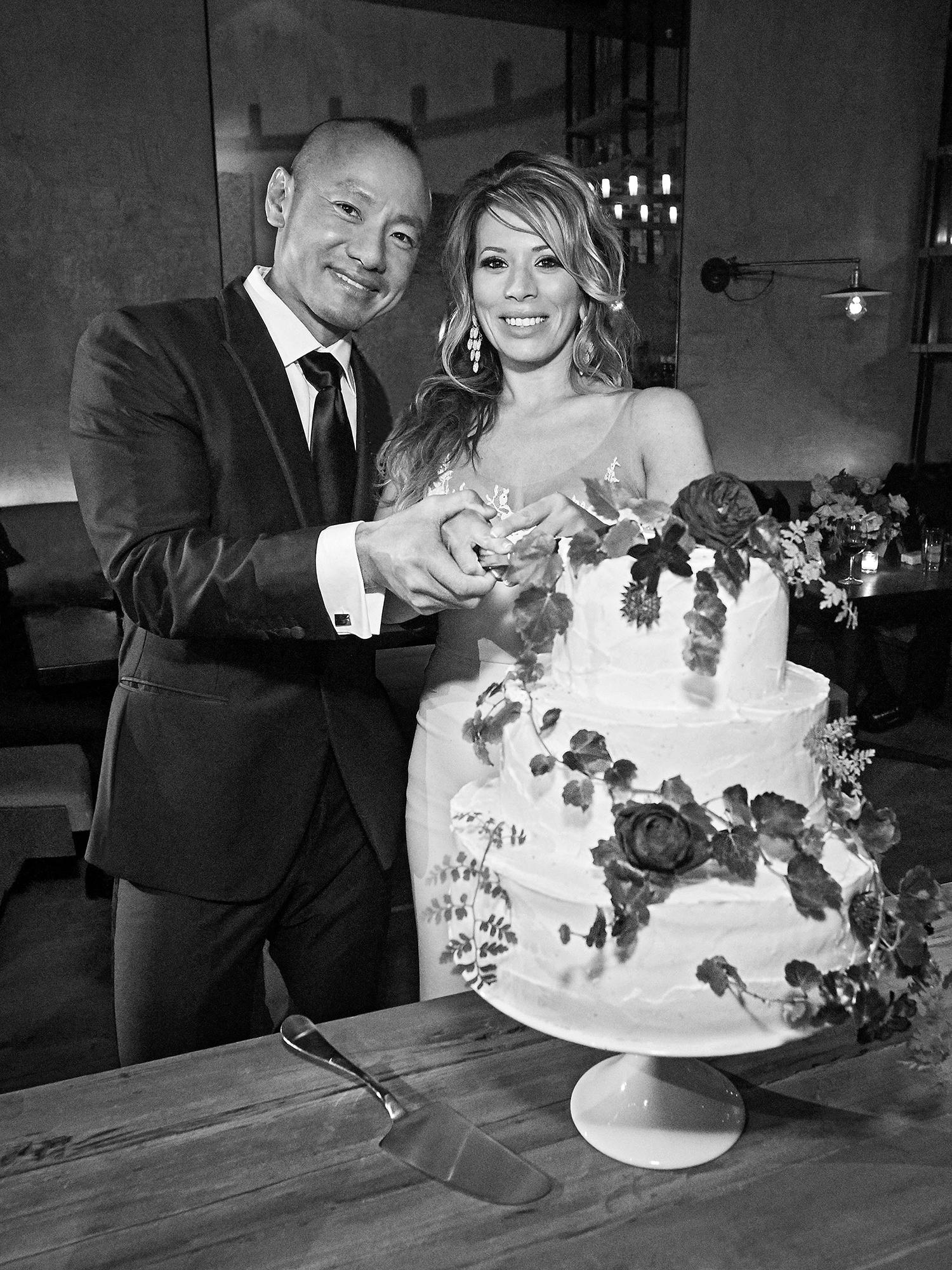 daisy eugene wedding cutting cake