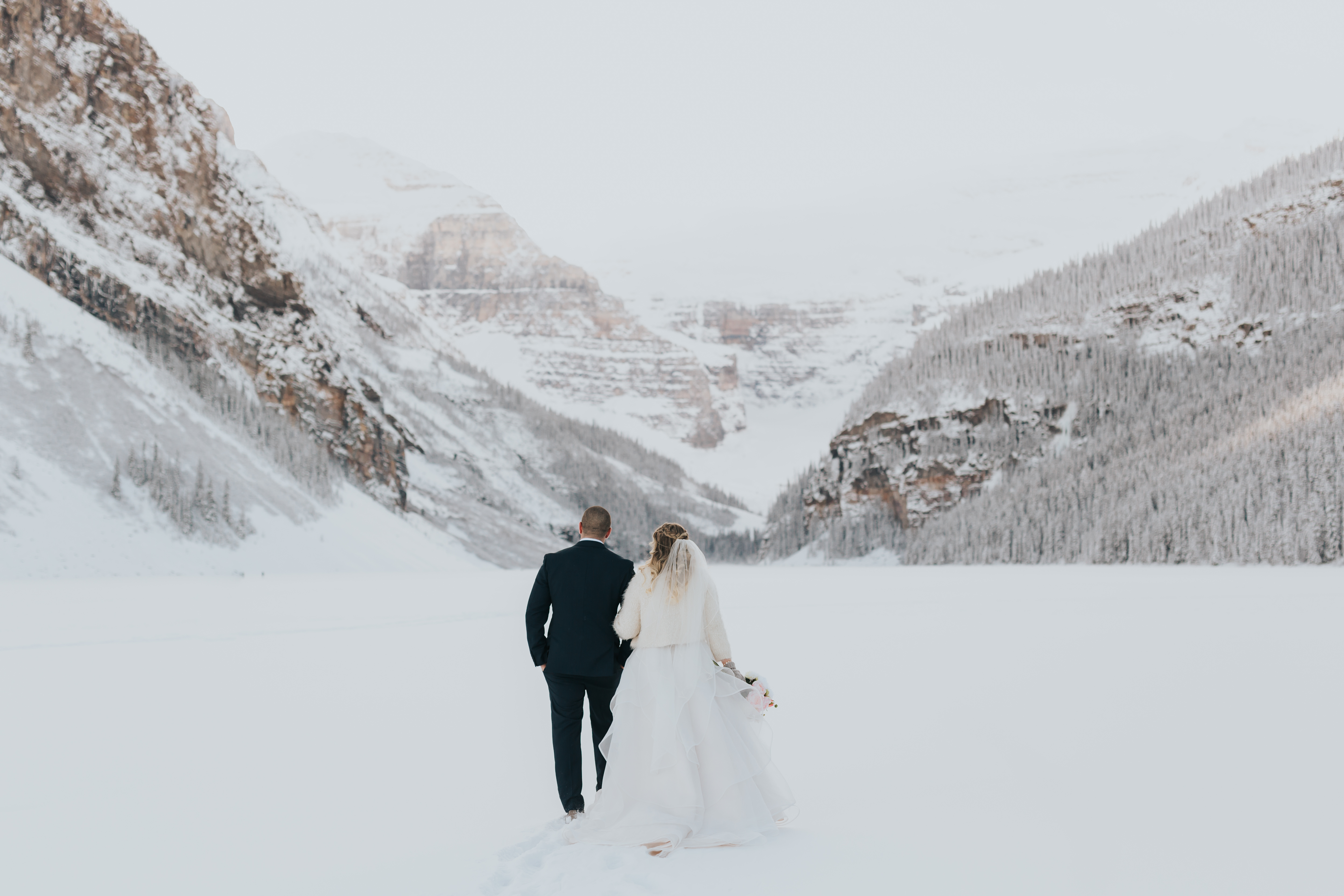 couple walking with mountain view