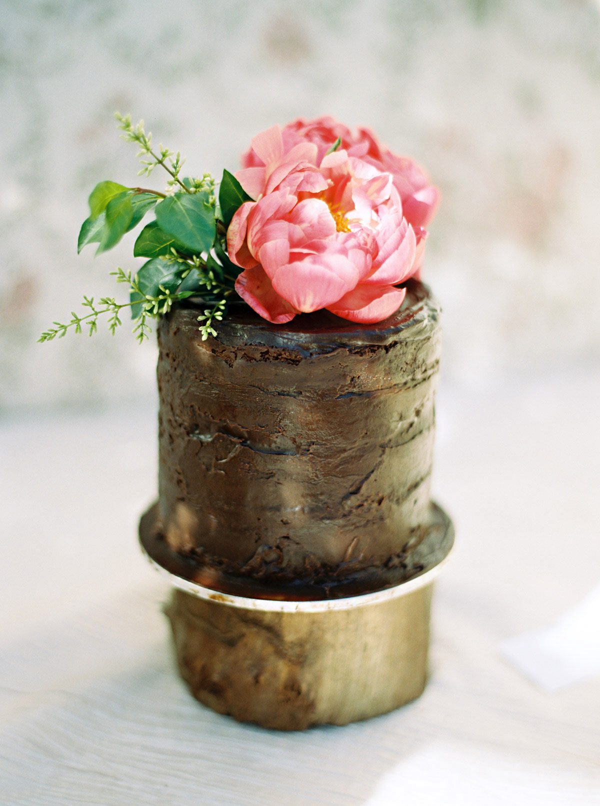 chocolate cake with pink bloom