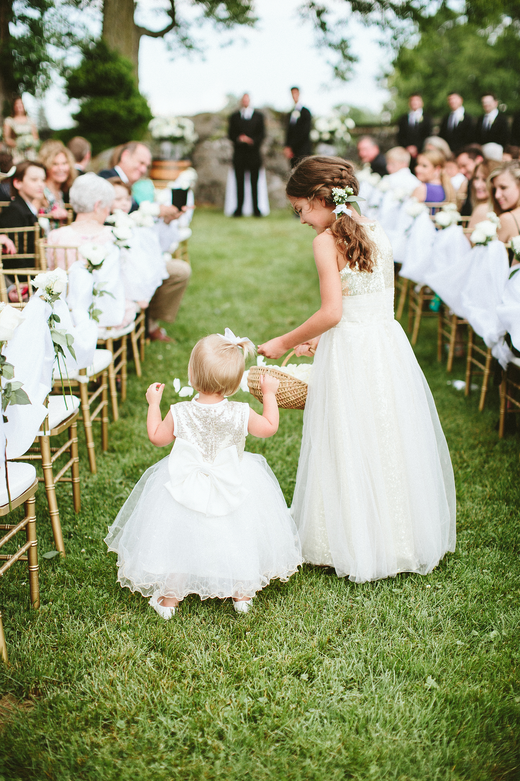 Read This Before Asking Your Flower Girl to Toss Petals Down the Aisle