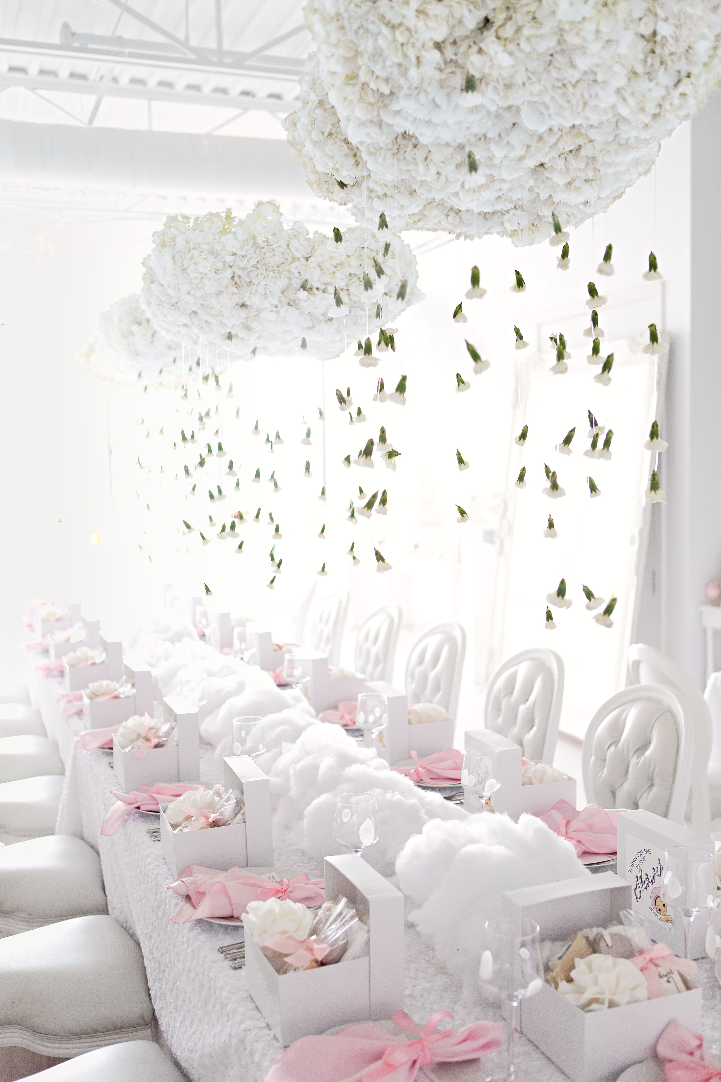 white tables cascading flower display