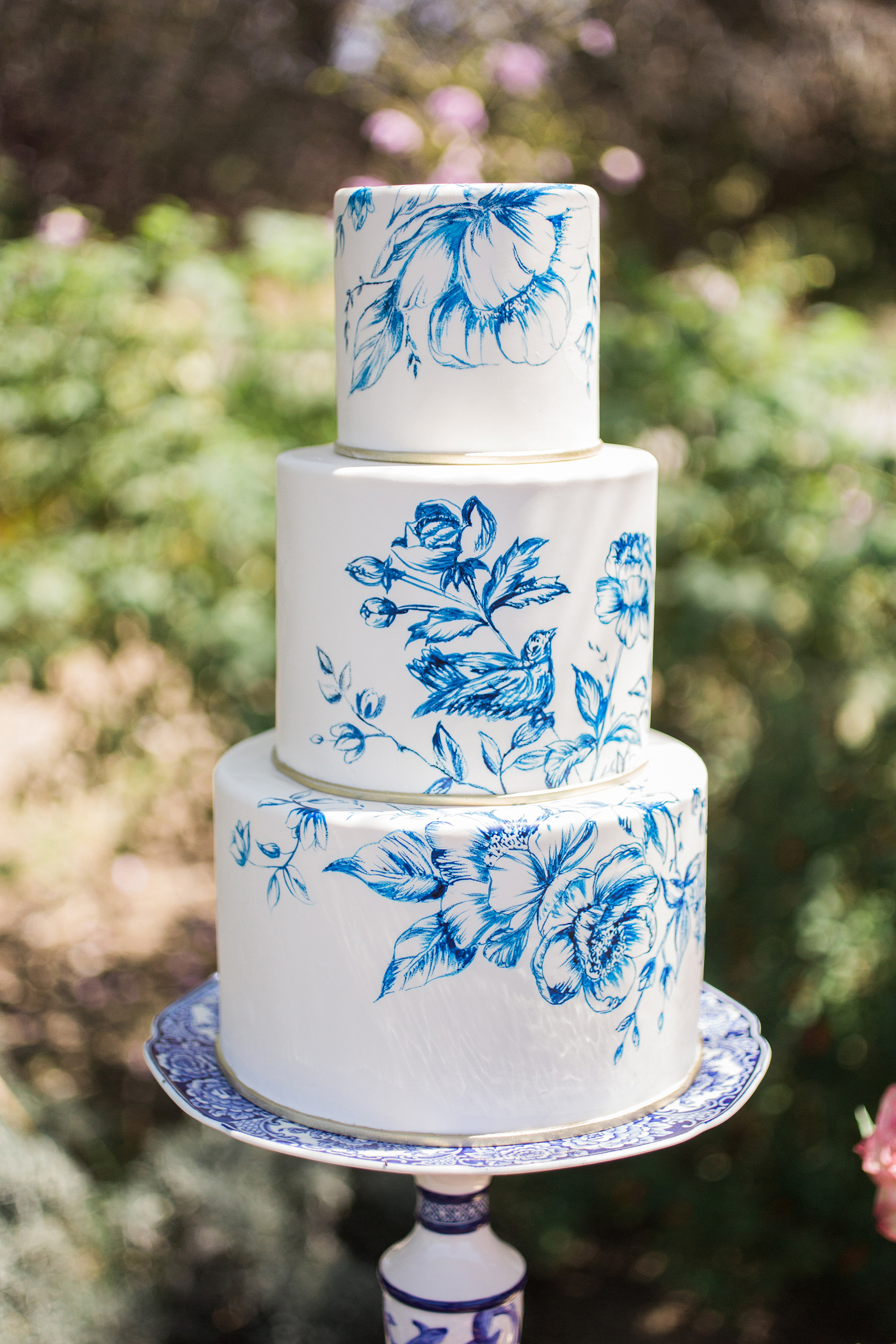blue white painted wedding cake