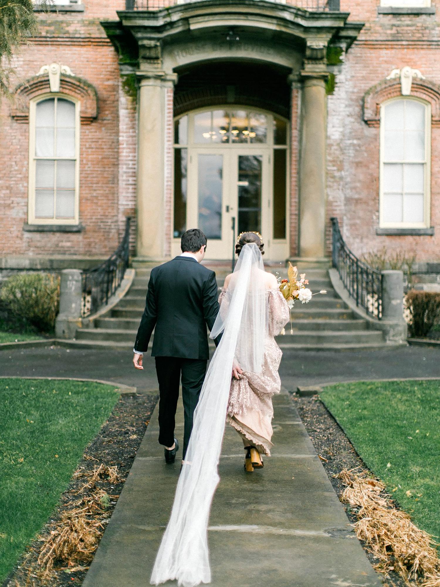 kae danny wedding couple walking into venue