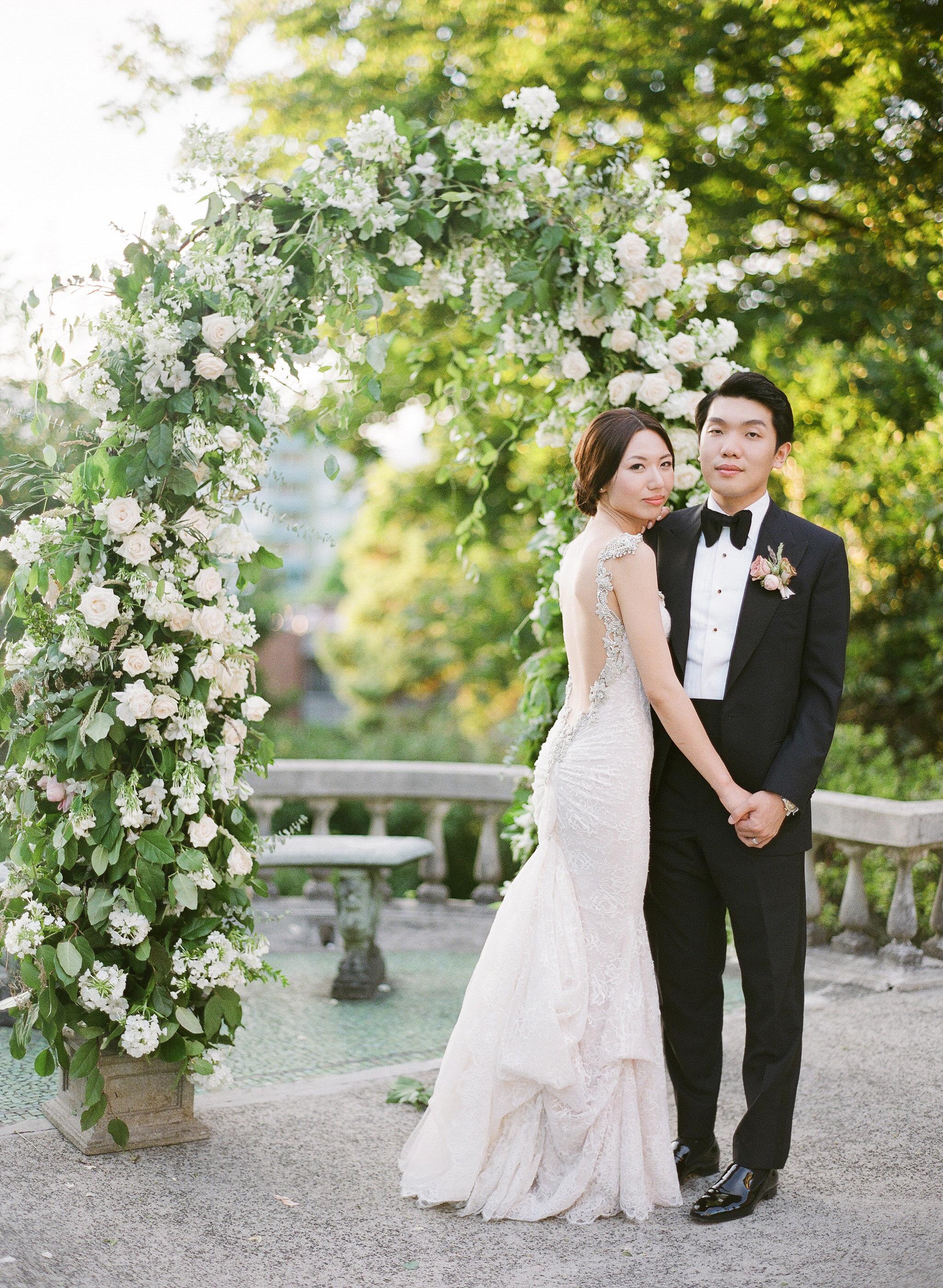gloria zee wedding couple arch holding hands