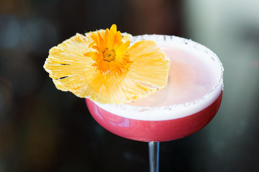cocktails red rock pink drink glass flower garnish