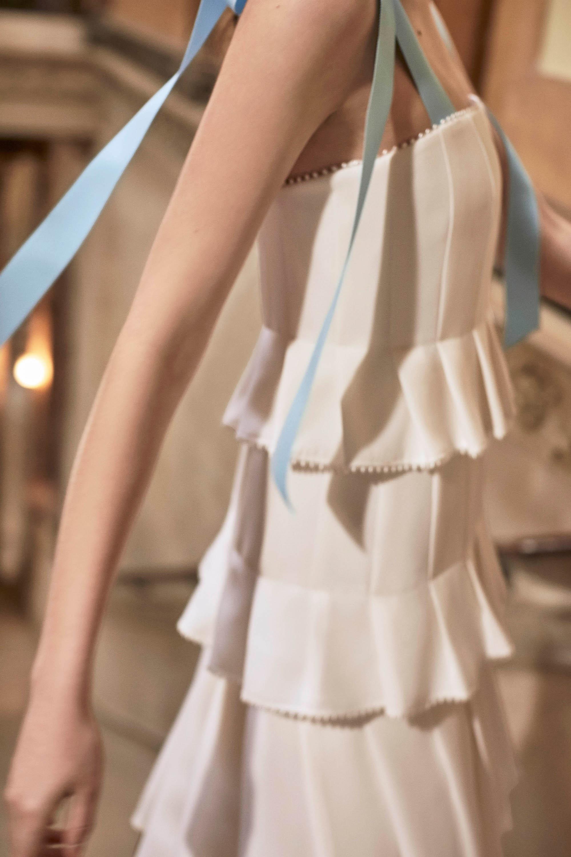 Carolina Herrera wedding dress spring 2019 sheath with ruffles and blue ribbon straps