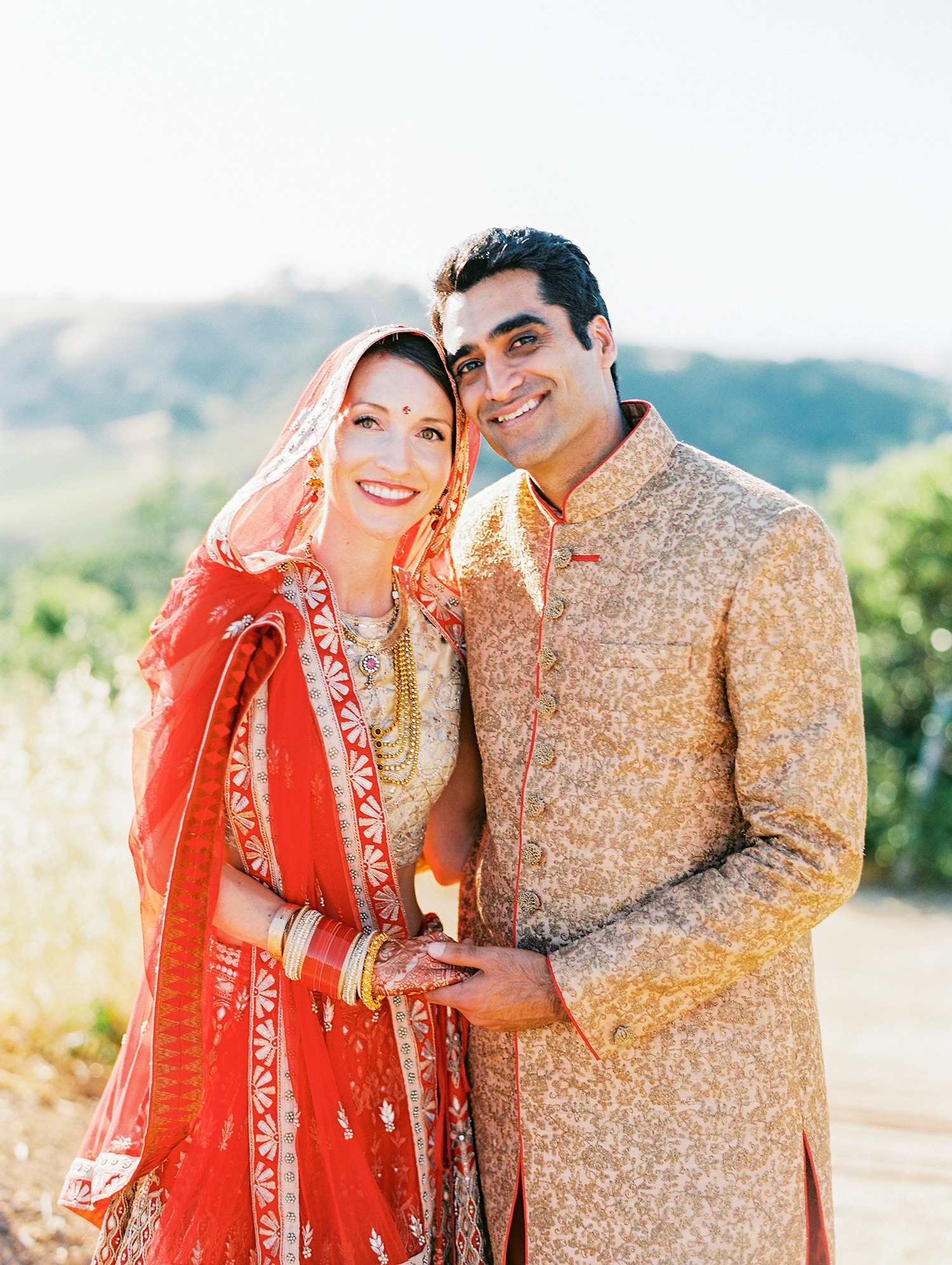 caitlin amit indian wedding couple holding hands