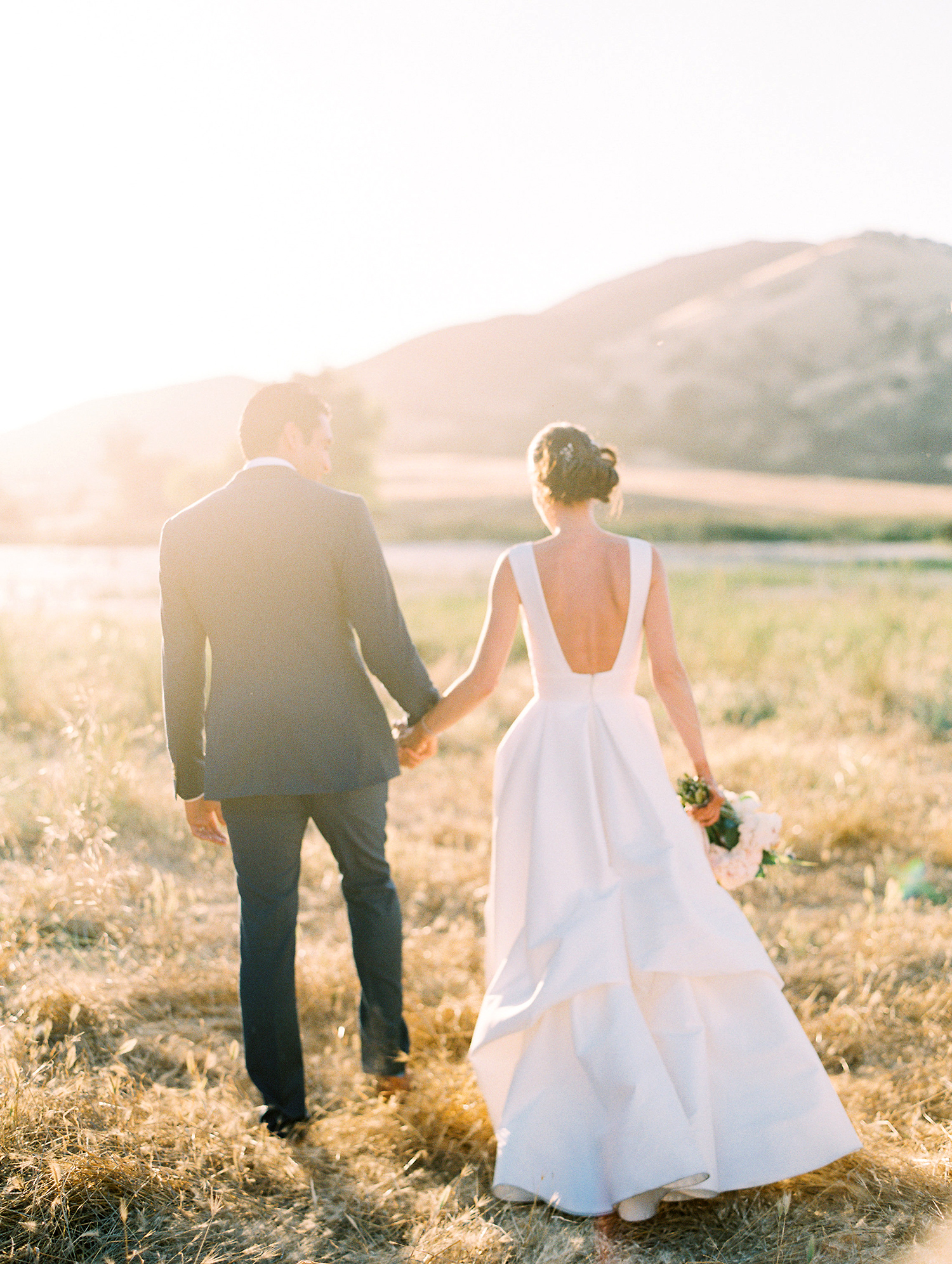 caitlin amit wedding couple walking in field