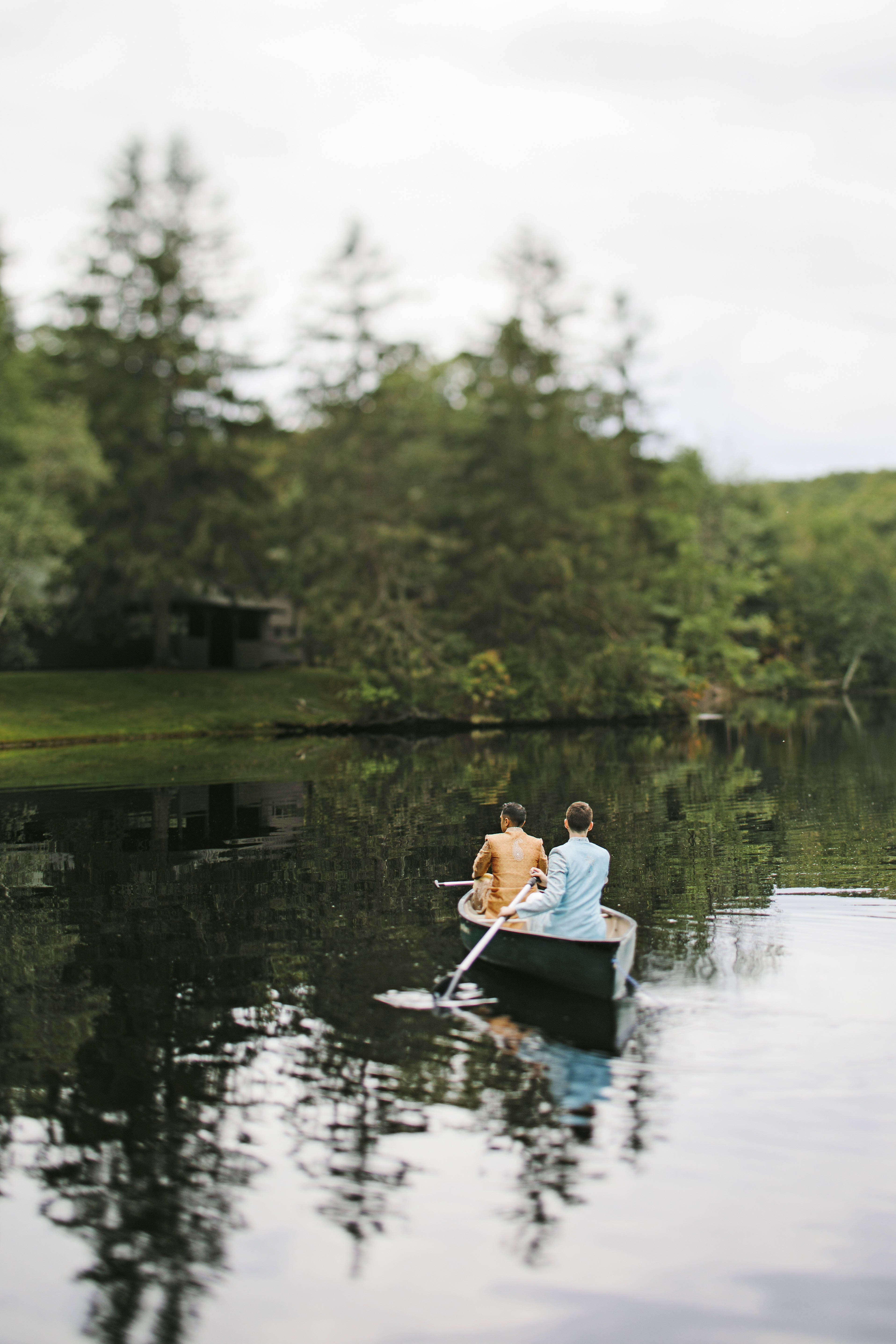sanjay steven wedding grooms canoe