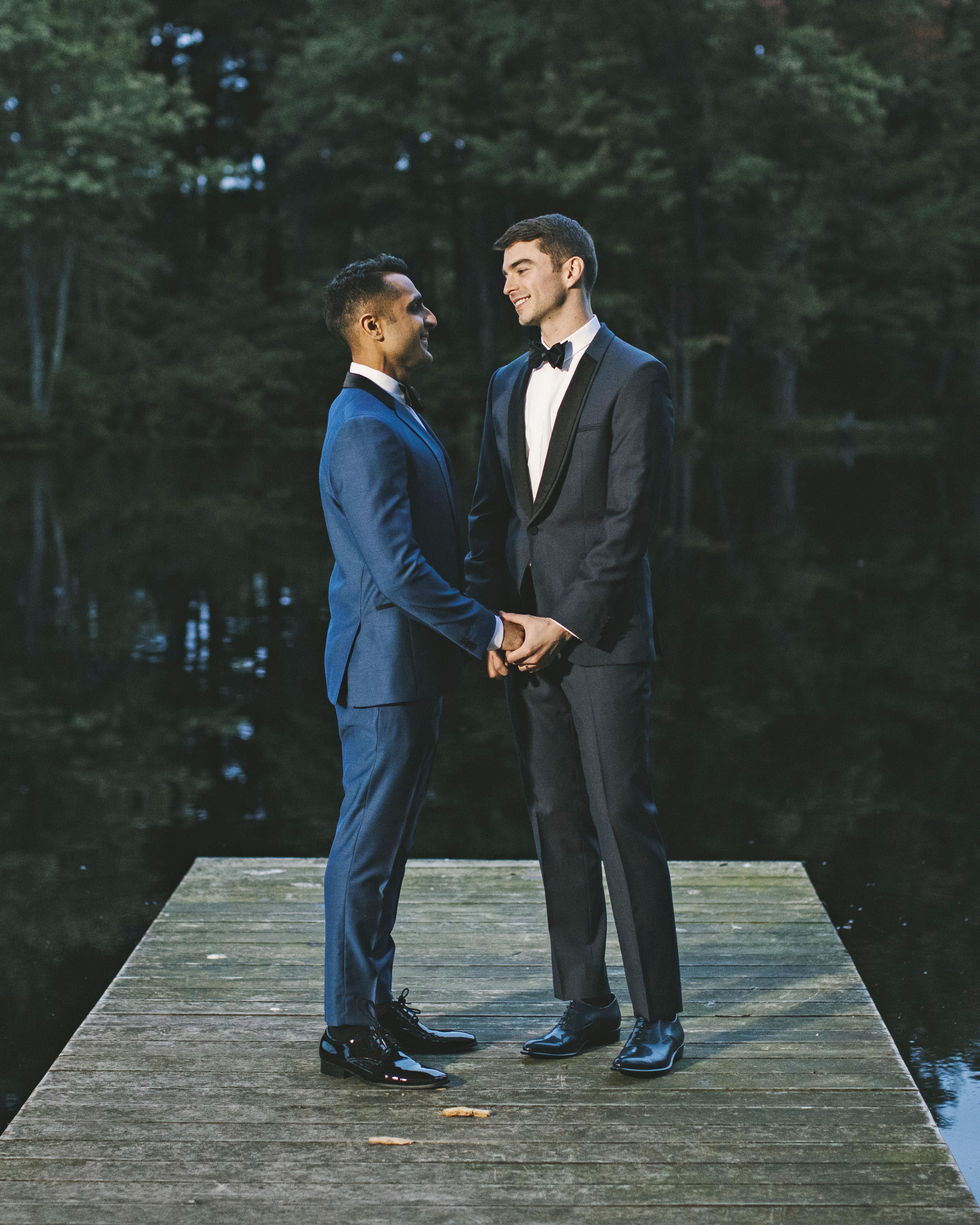 sanjay steven wedding grooms on dock at night