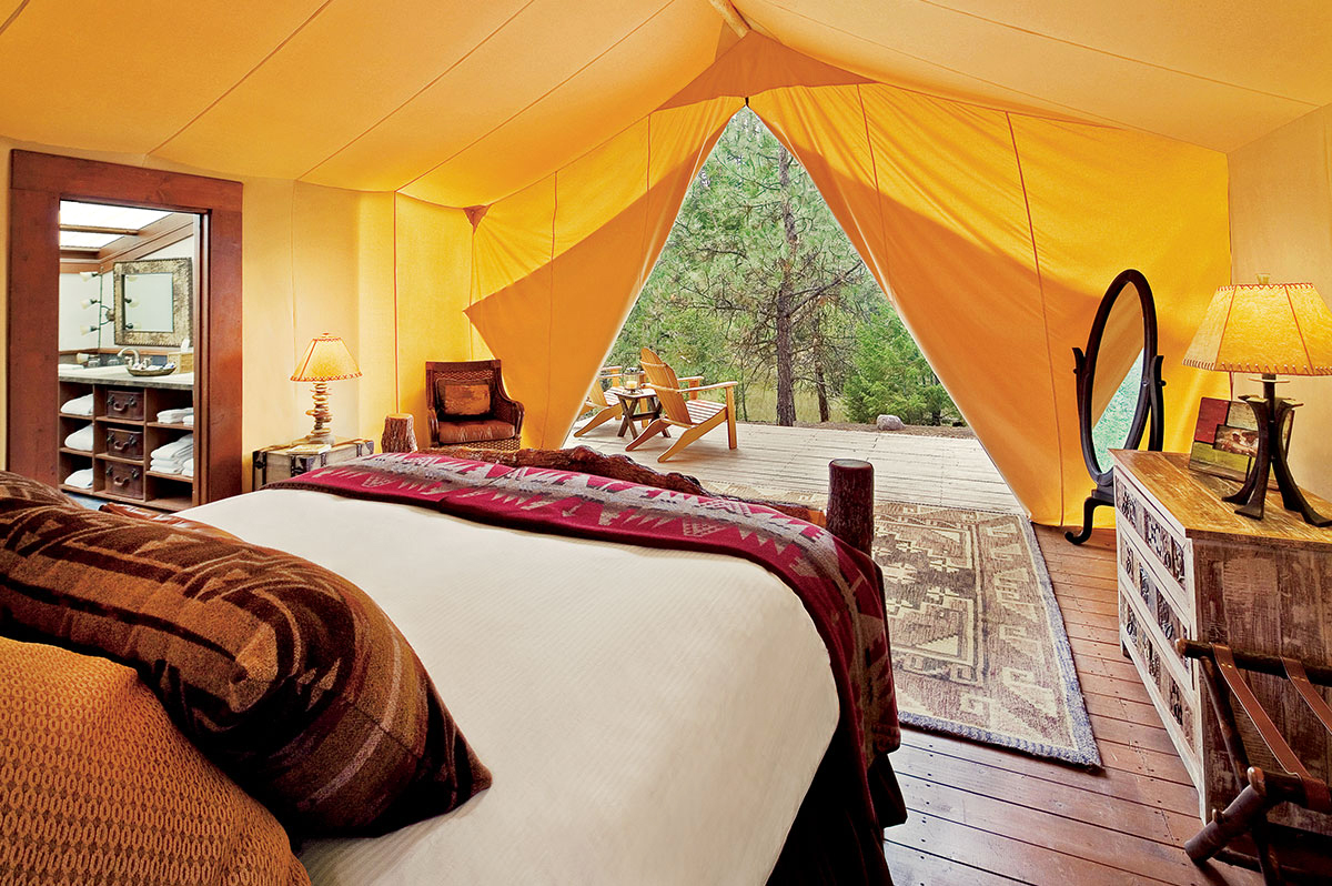 dude ranch honeymoon the resort at paws up yellow tent bed interior