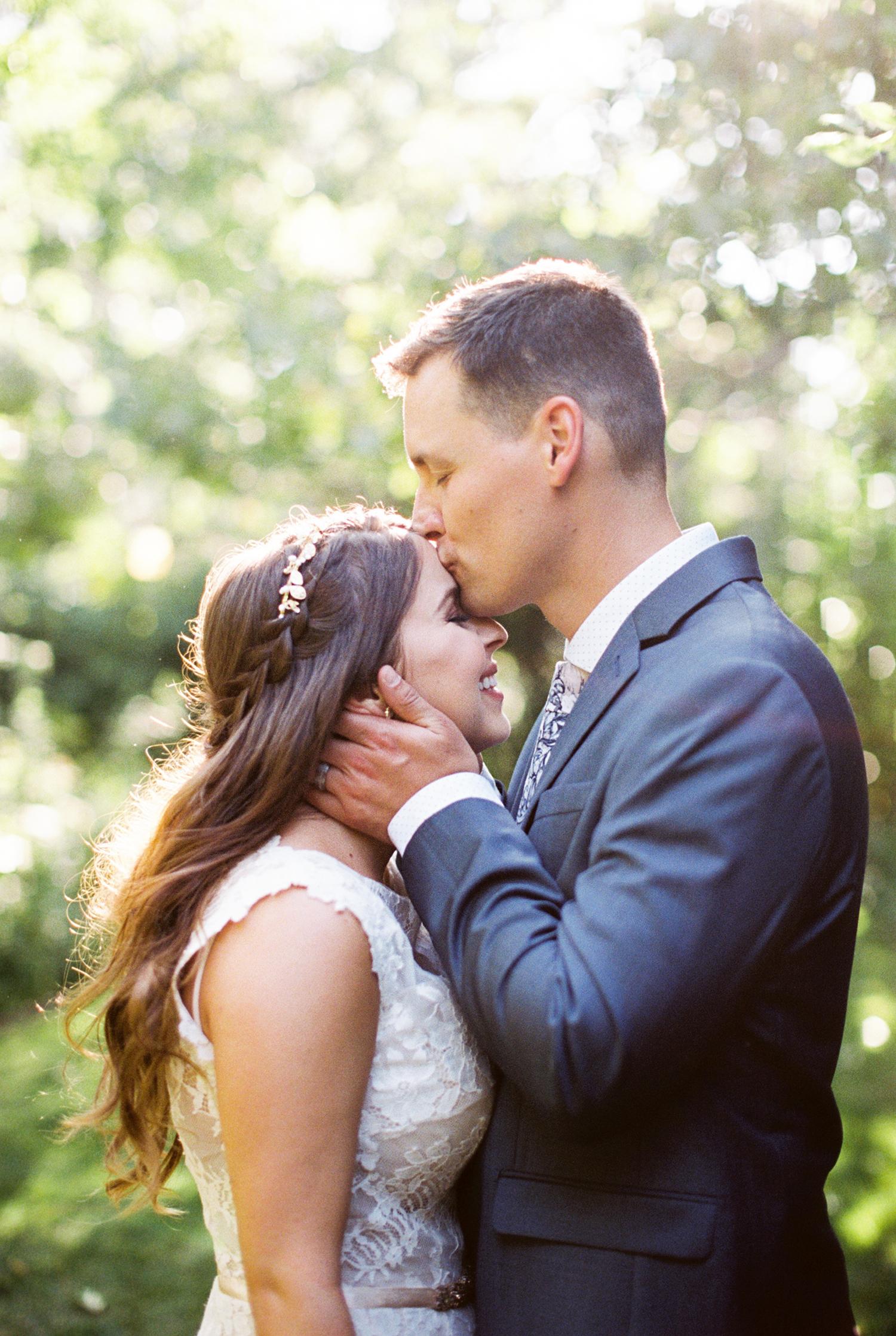 megan scott wedding groom kissing bride