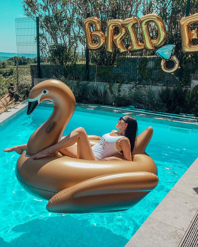 real brides bachelorette poolside swan float