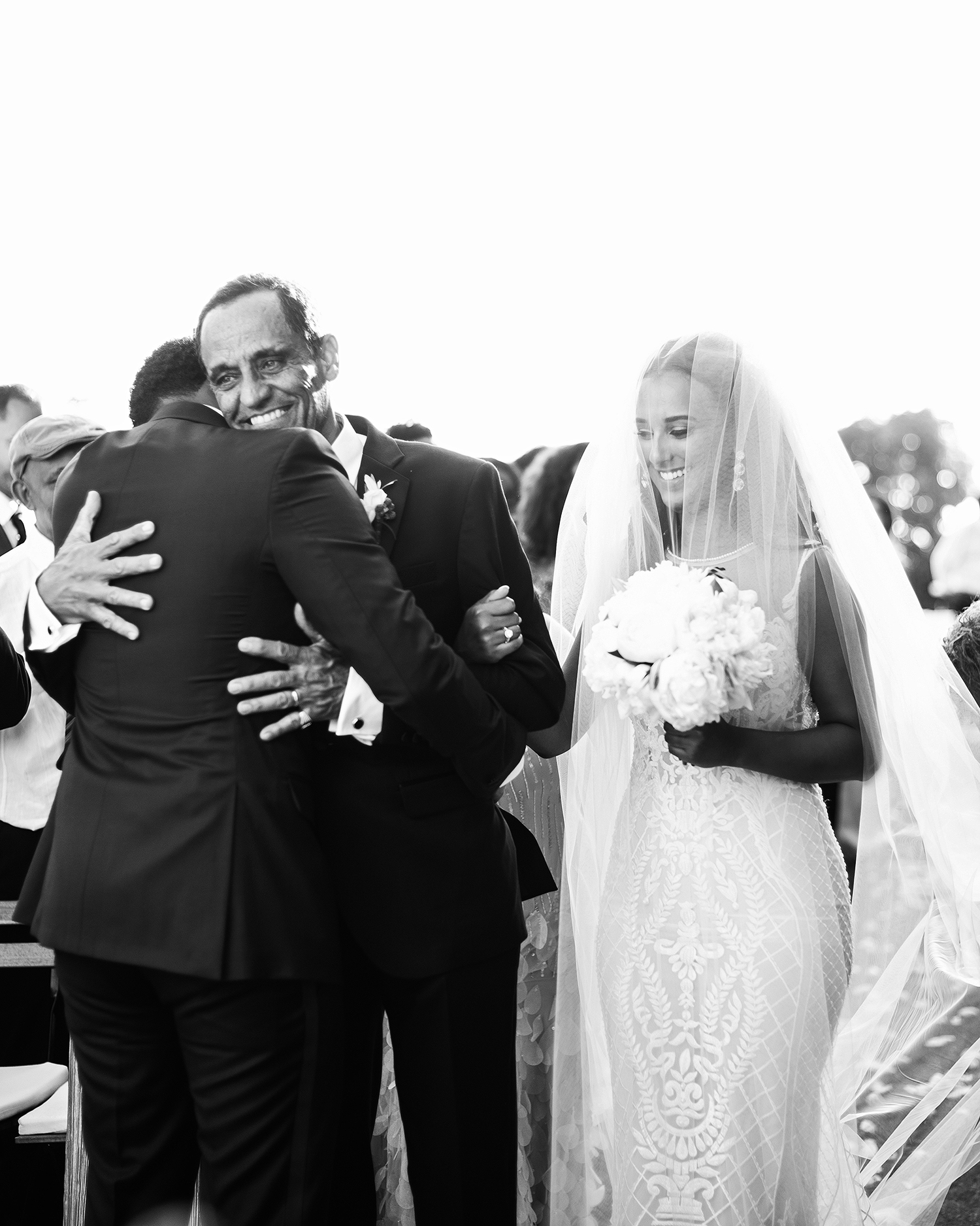 veronica mickias wedding groom and father embrace