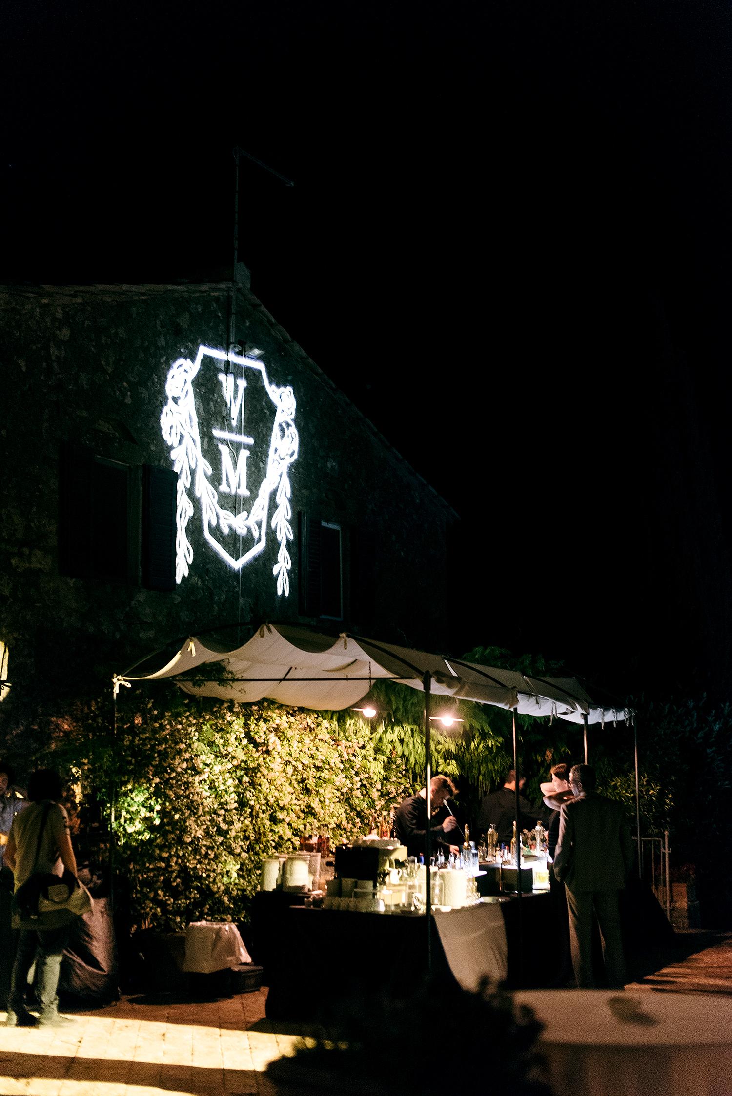 veronica mickias wedding outdoor bar projection