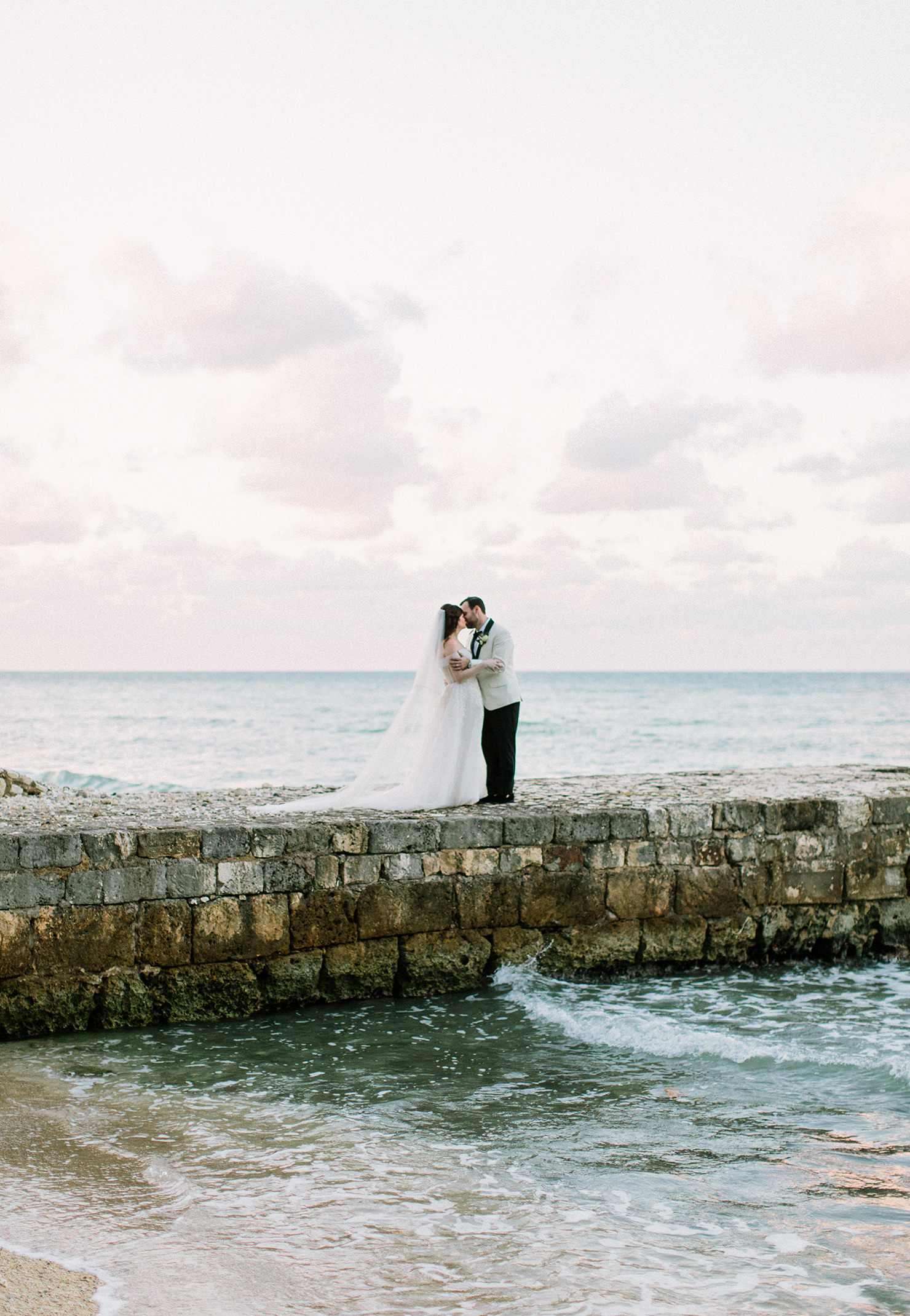 abbey jeffrey wedding couple kiss on stone pier
