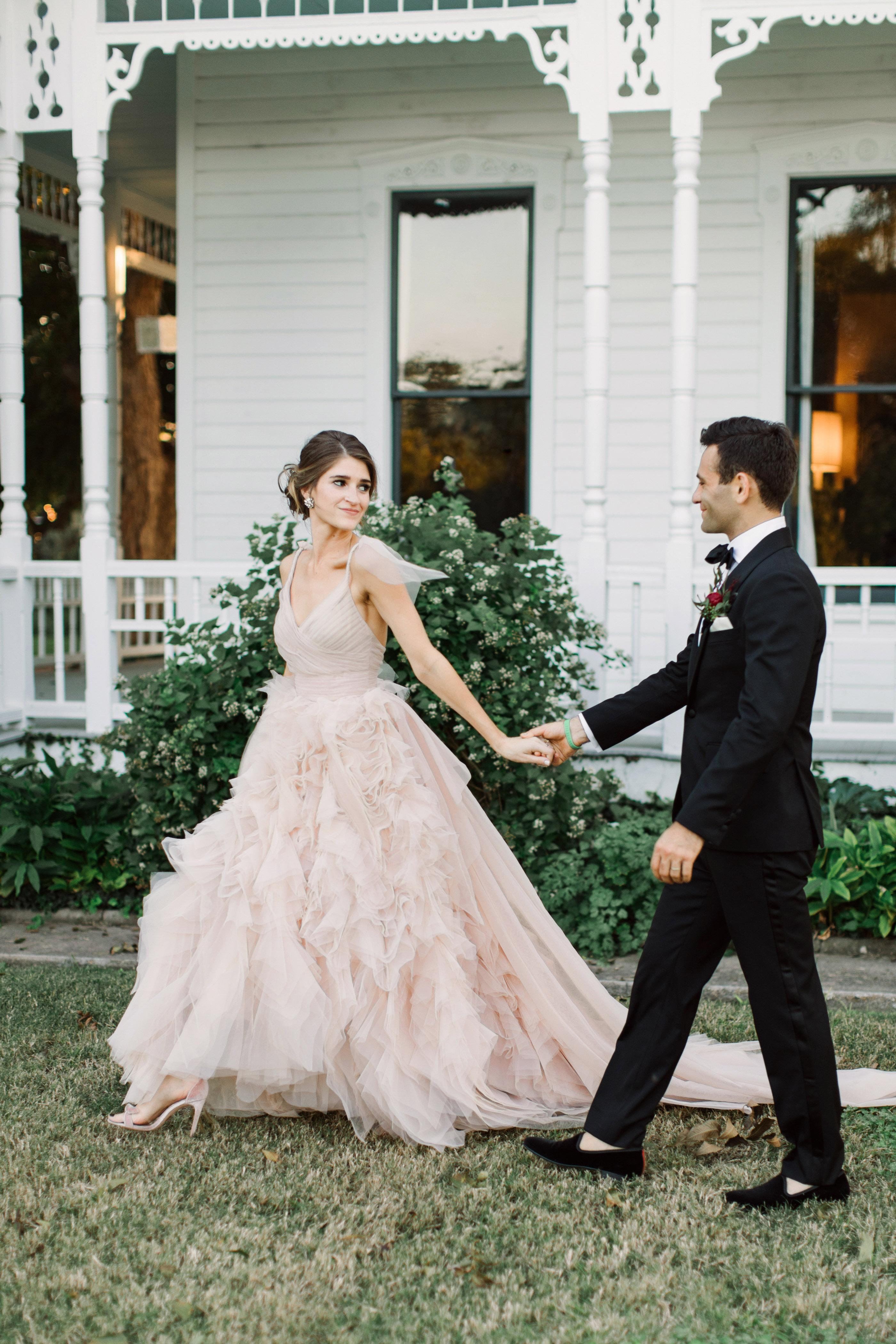wedding couple portraits walking mansion