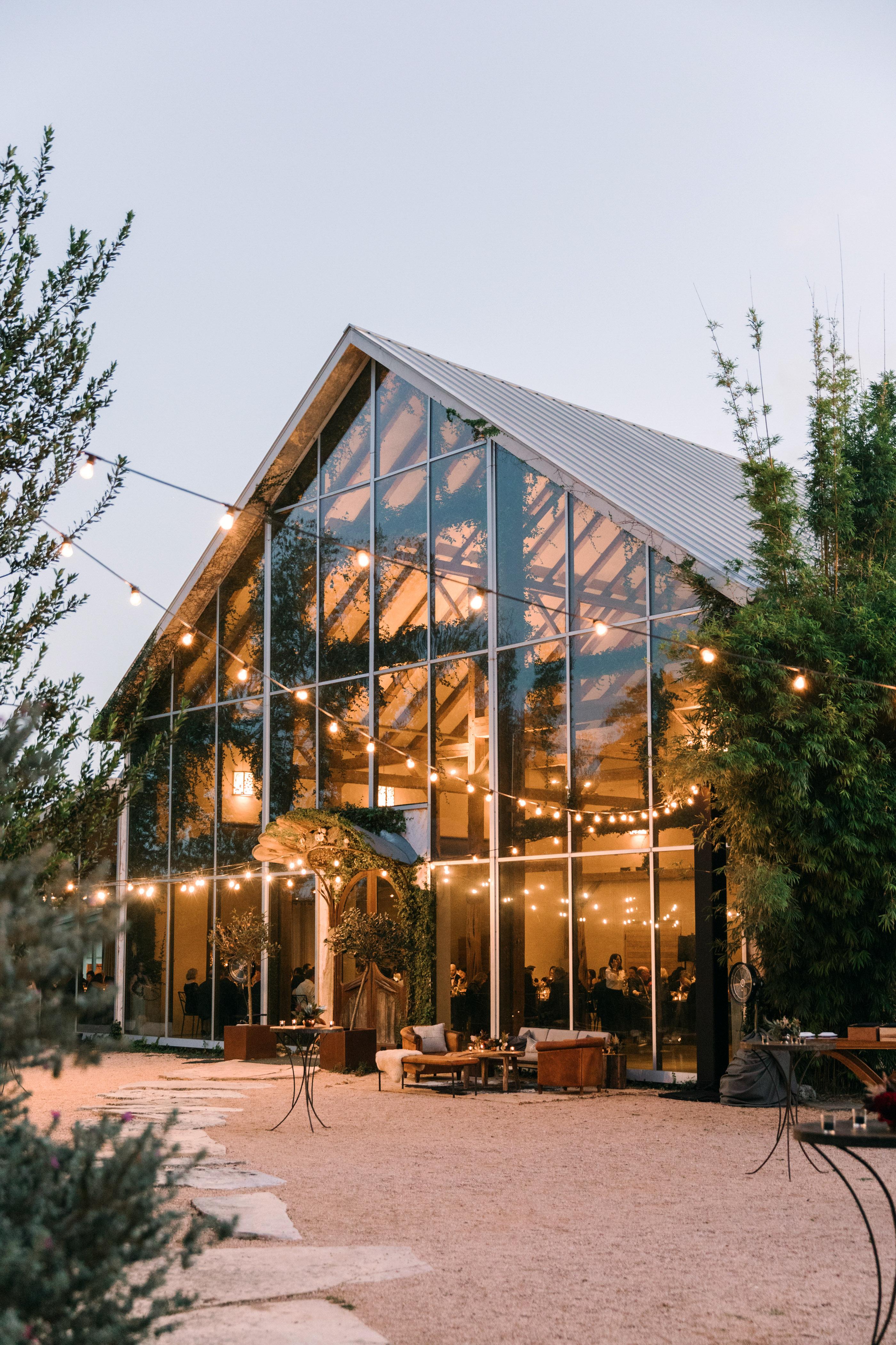 wedding reception venue glass front bistro lights