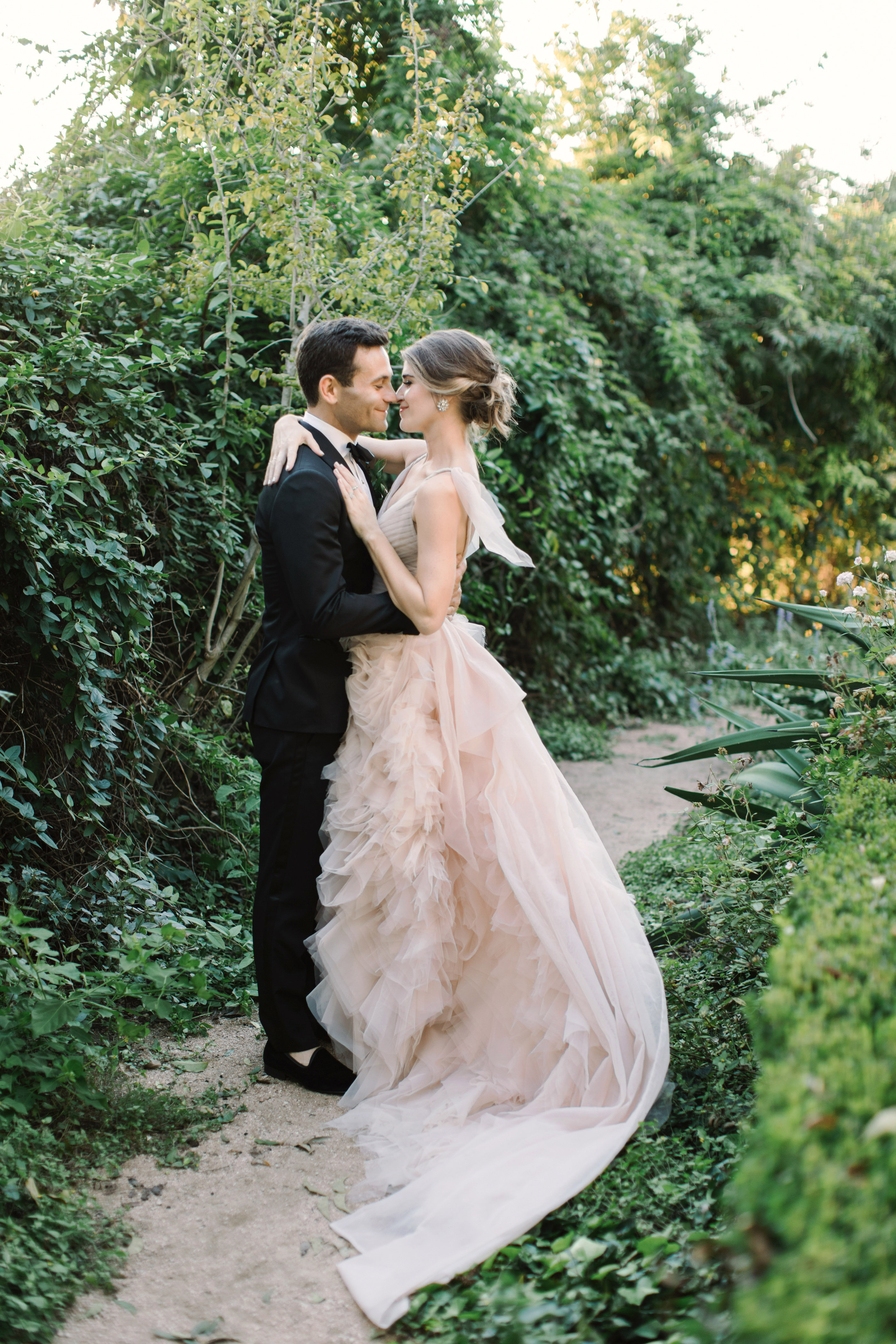 wedding couple portraits embrace greenery