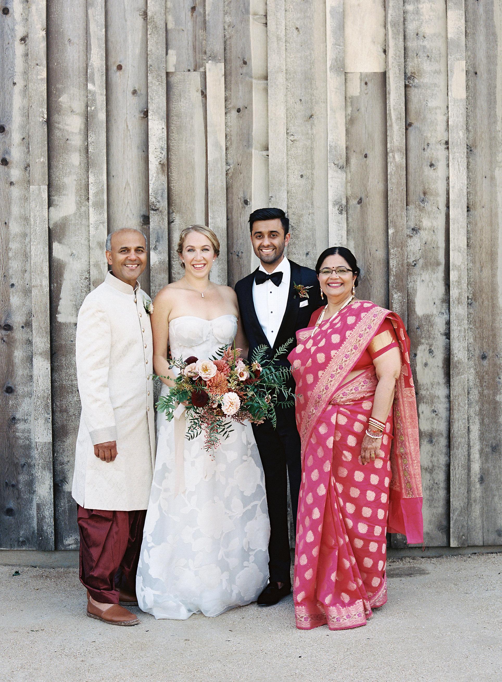 emily siddartha wedding parents outside
