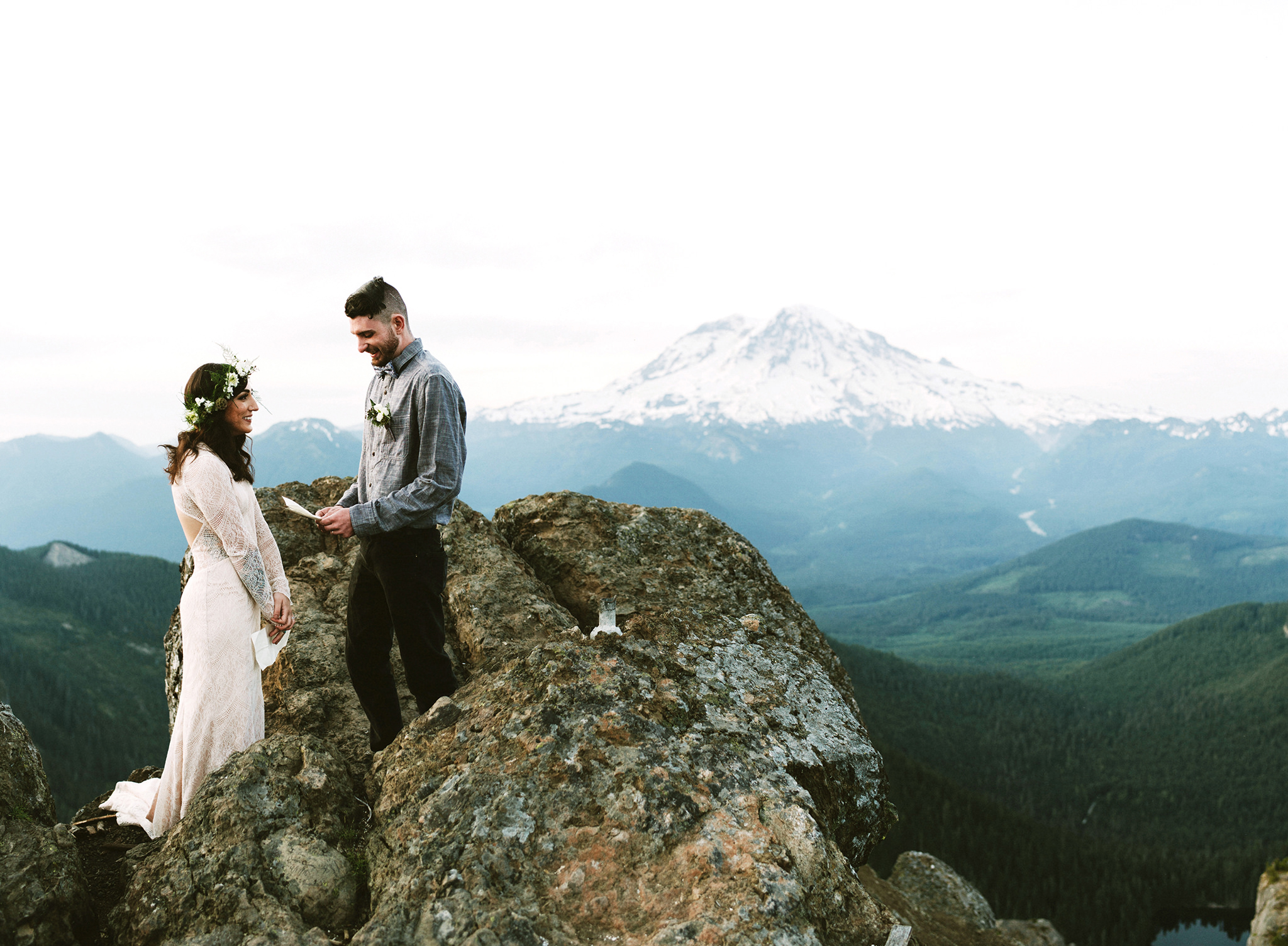 epic wedding photos benj haisch couple on cliff