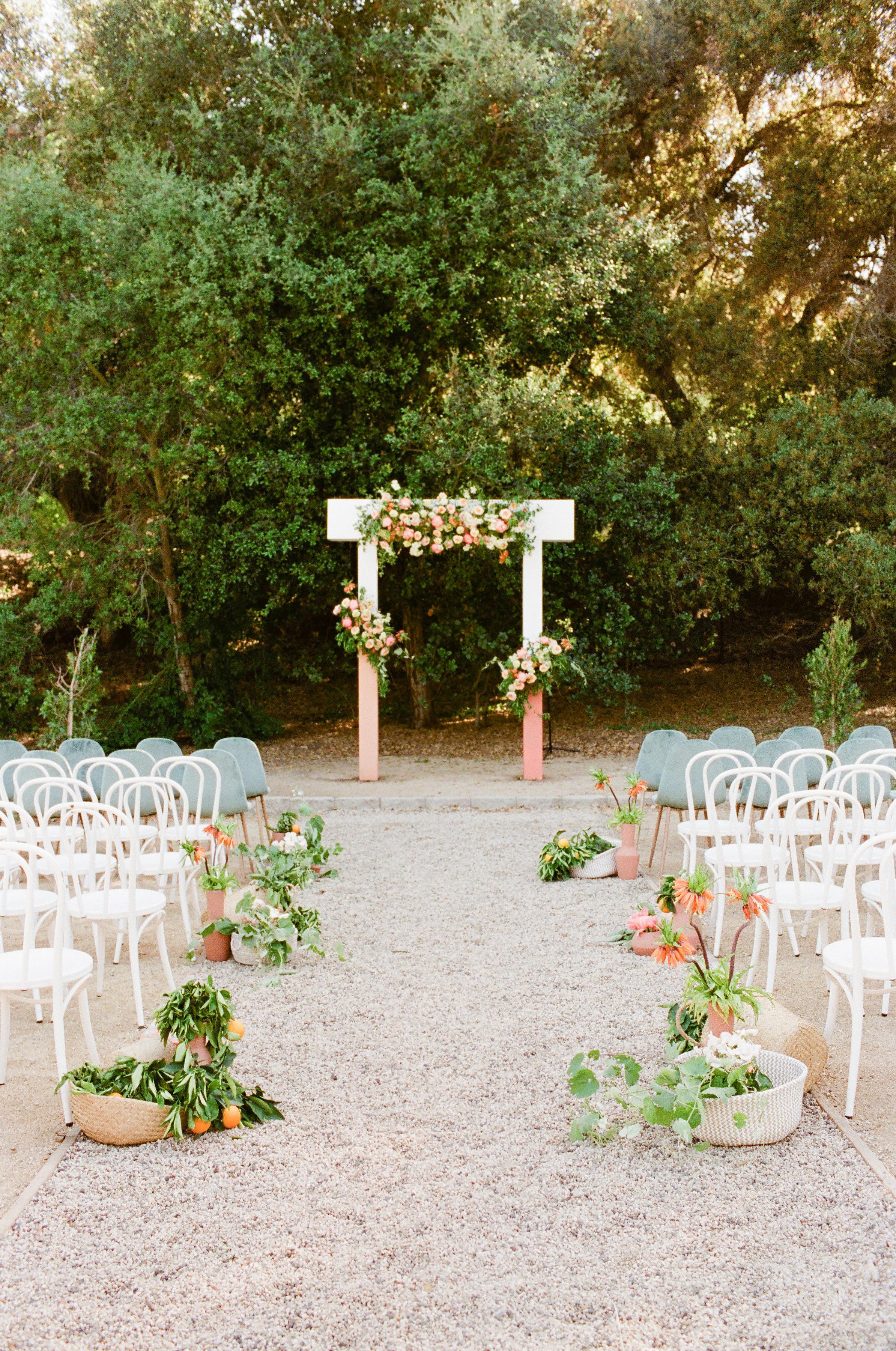 Tenley molzahn taylor leopold wedding ceremony flowered arch