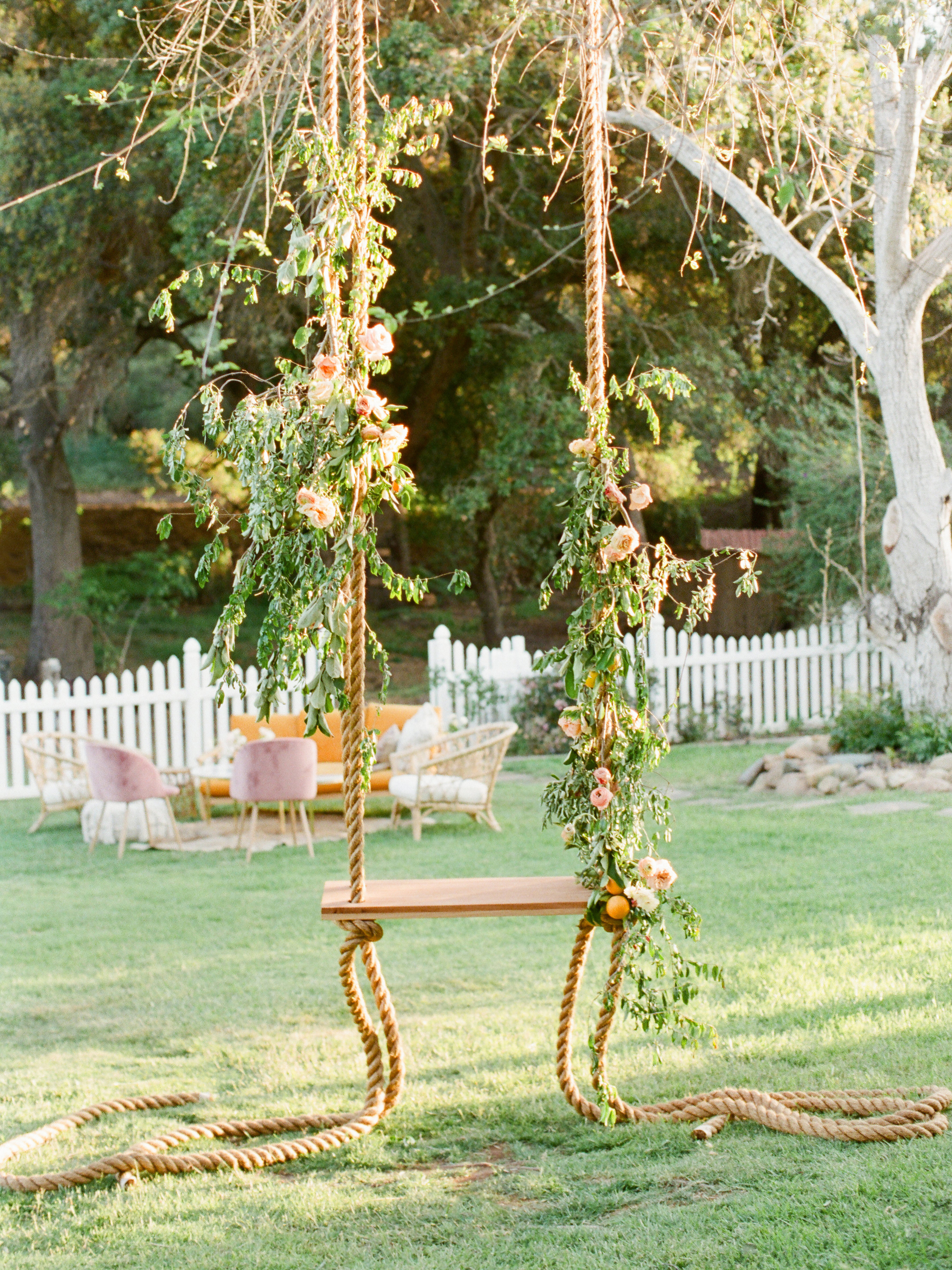 Tenley molzahn taylor leopold wedding swing greenery