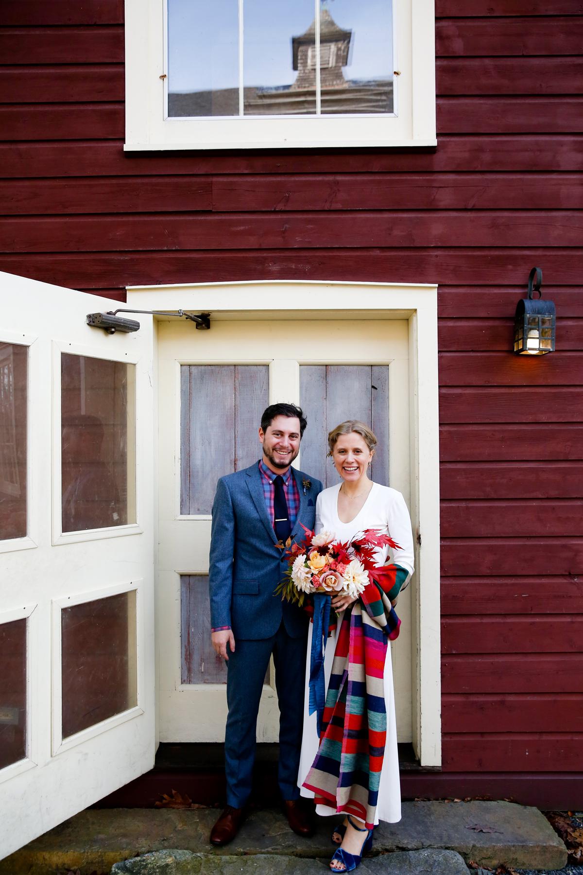 tory jonathan wedding couple in front of door