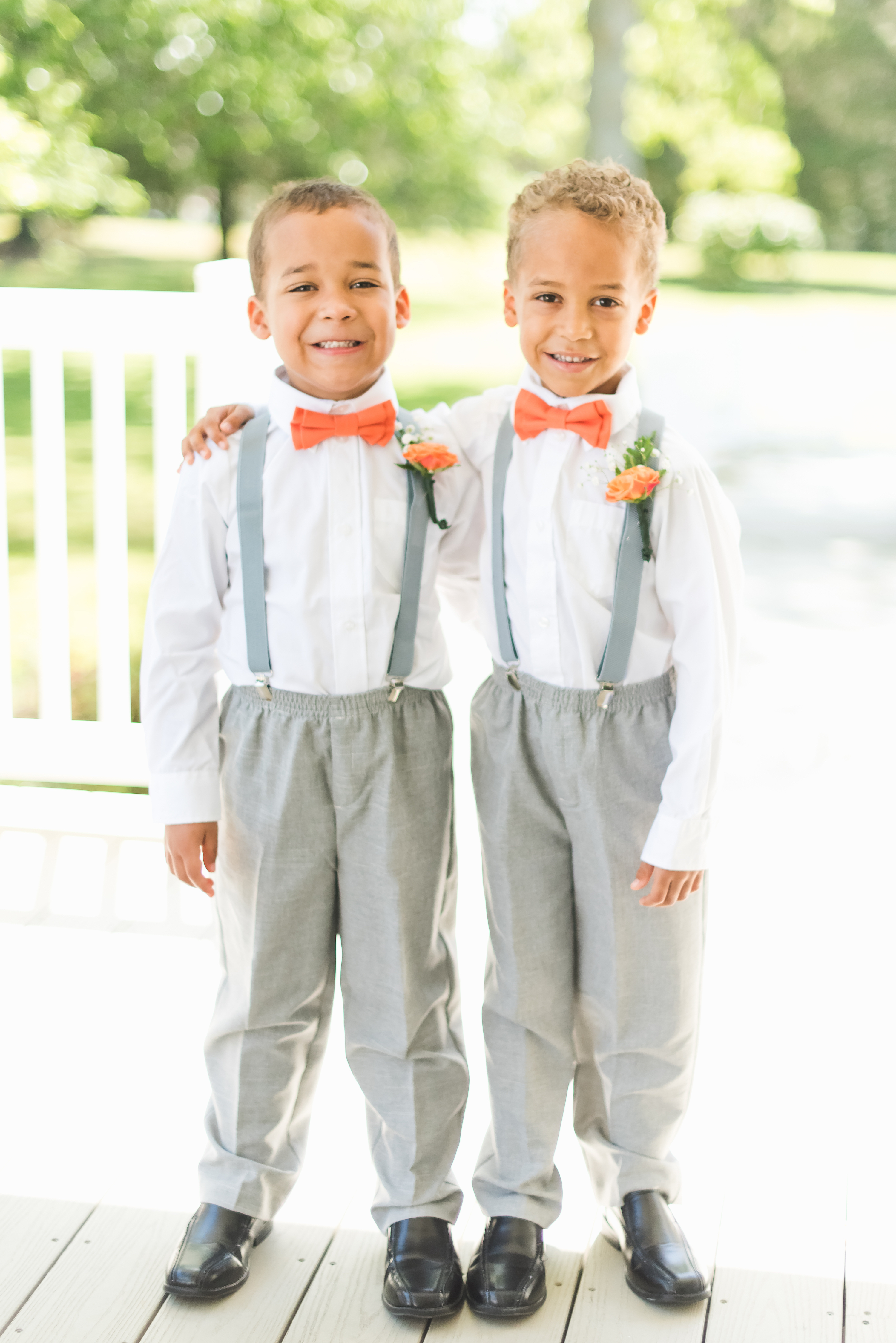 ring bearers with orange boutonnieres