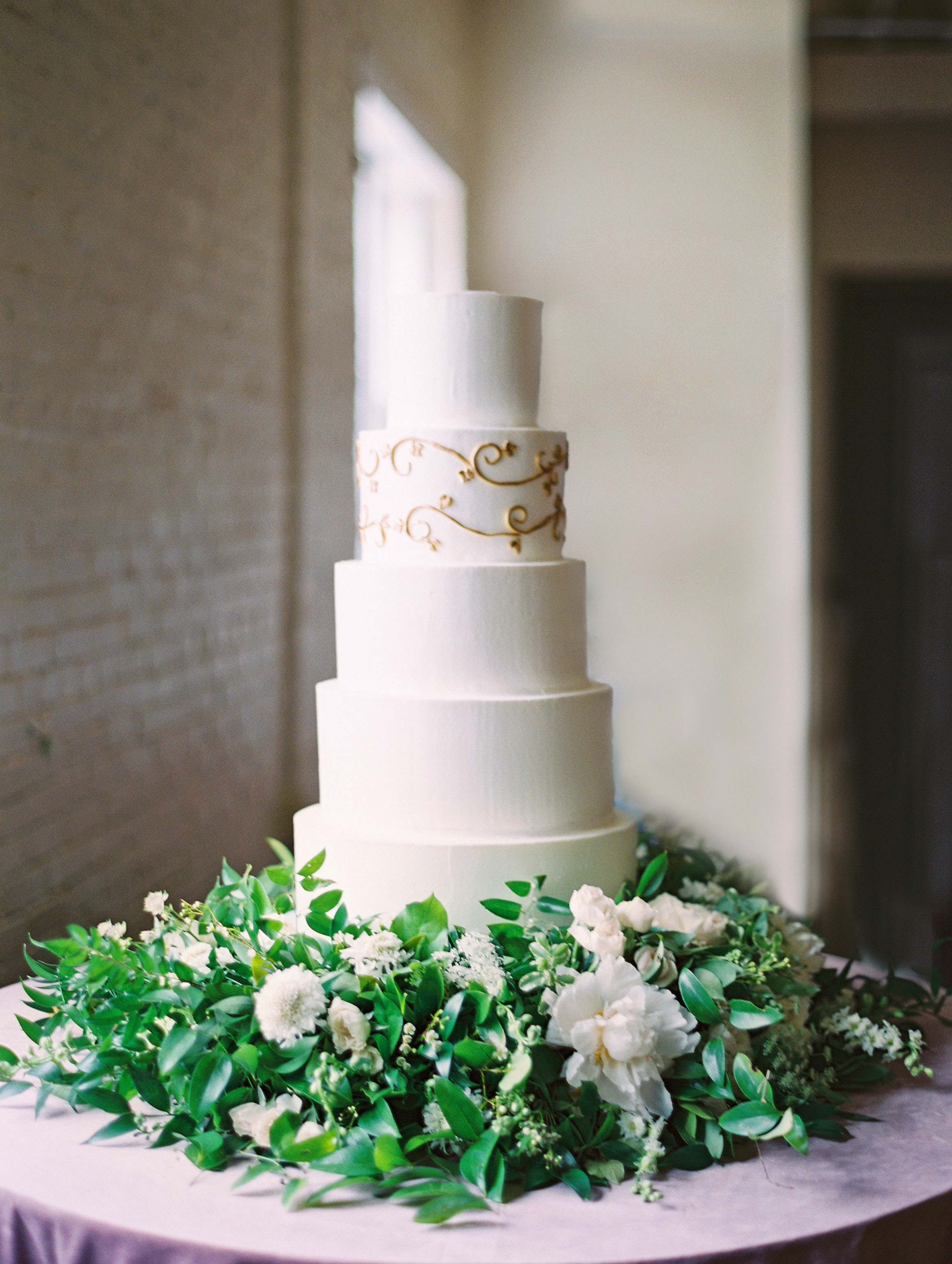 wreathed cake with stacked levels