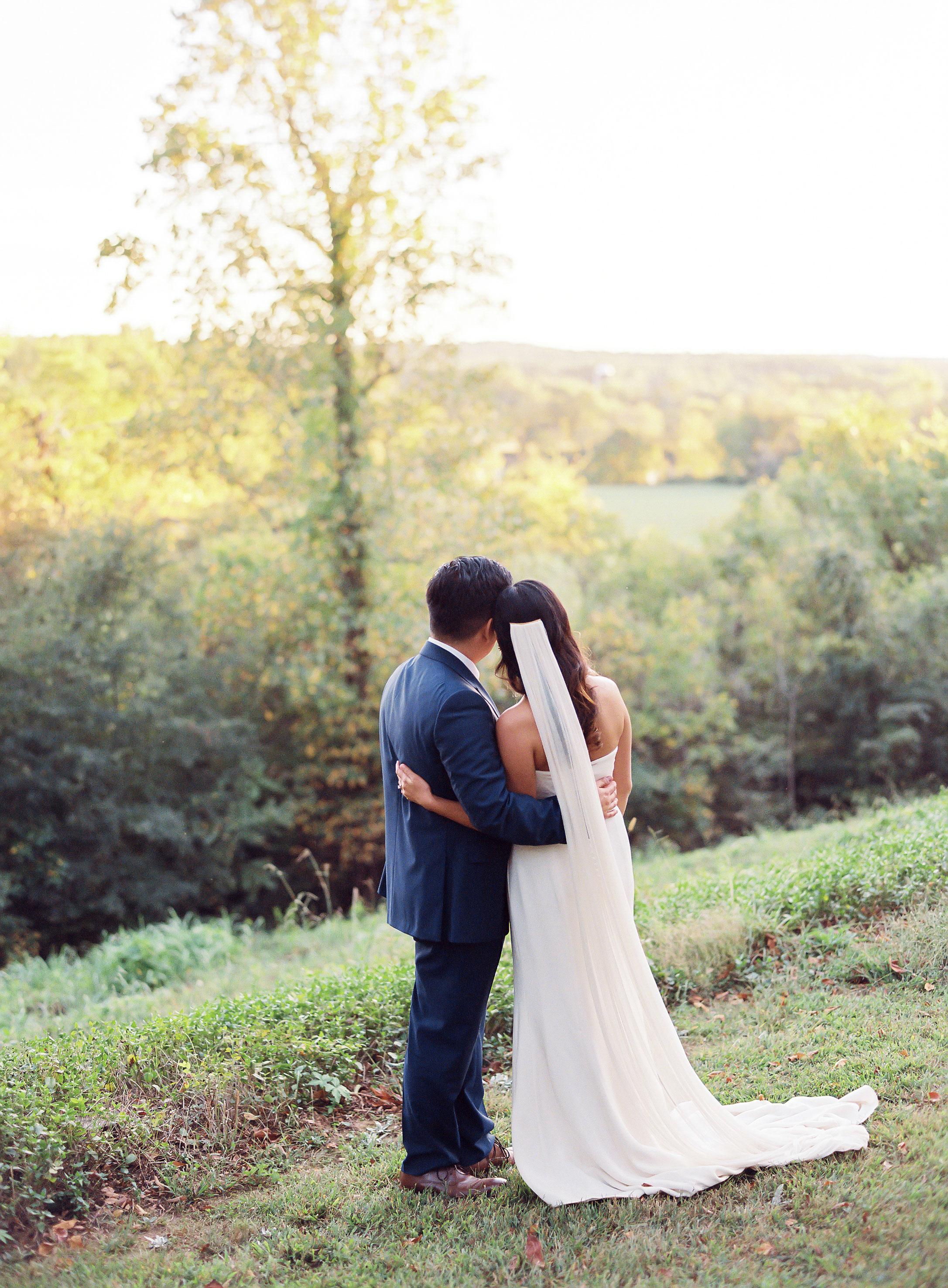 linda robert wedding couple embrace
