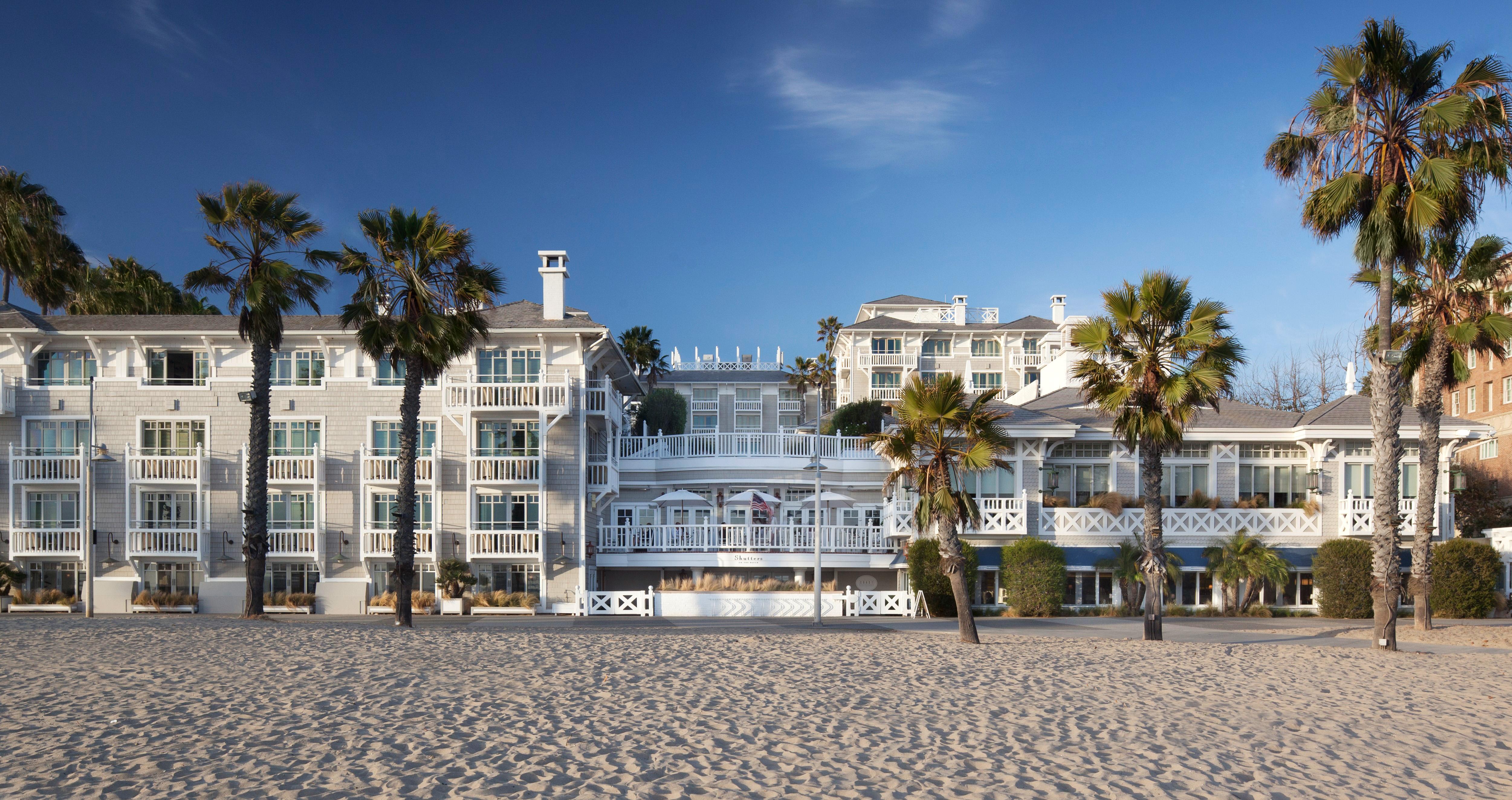 city meets beach hotel shutters on the beach palm trees