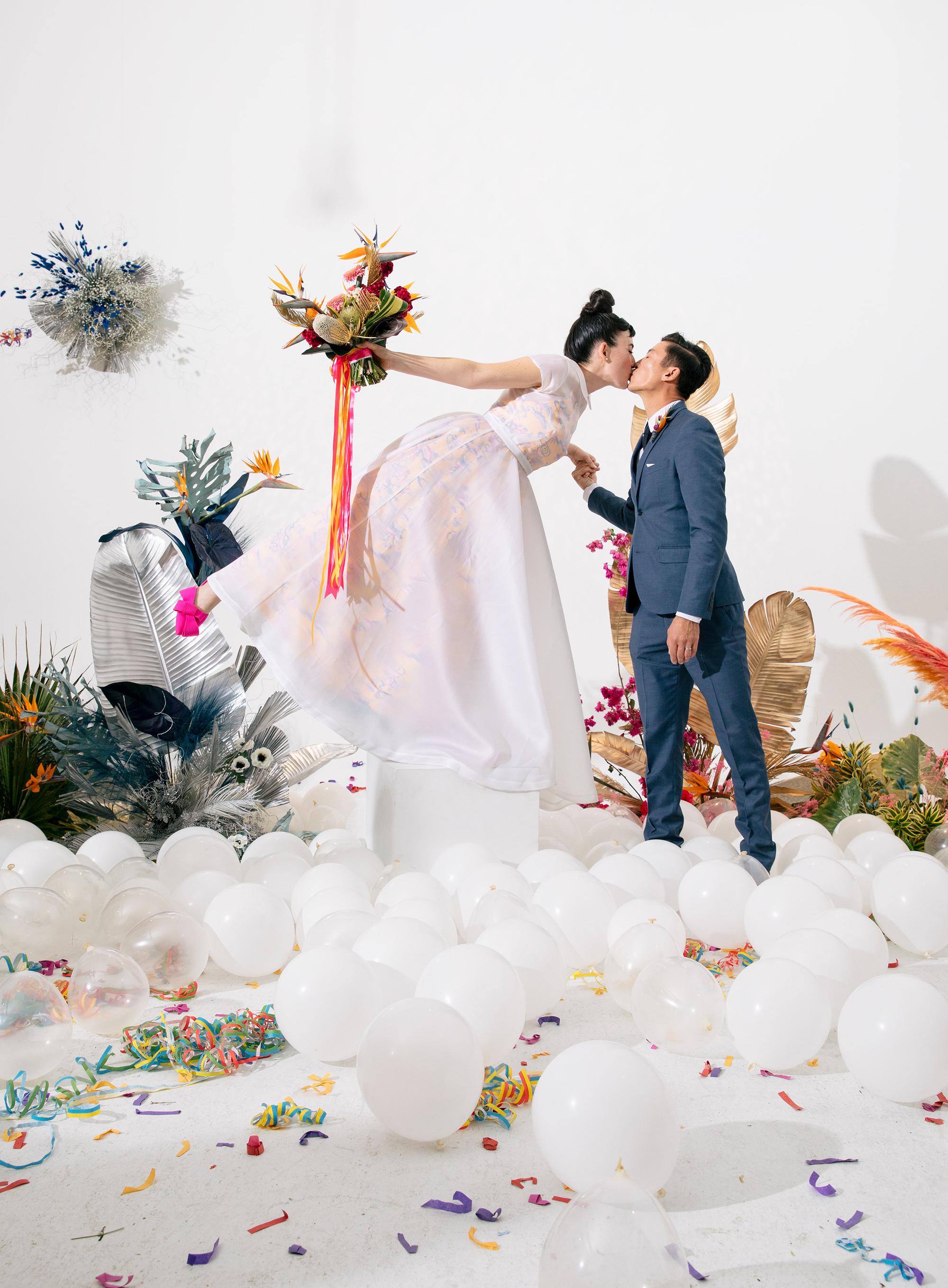 tashina huy colorful wedding couple kiss