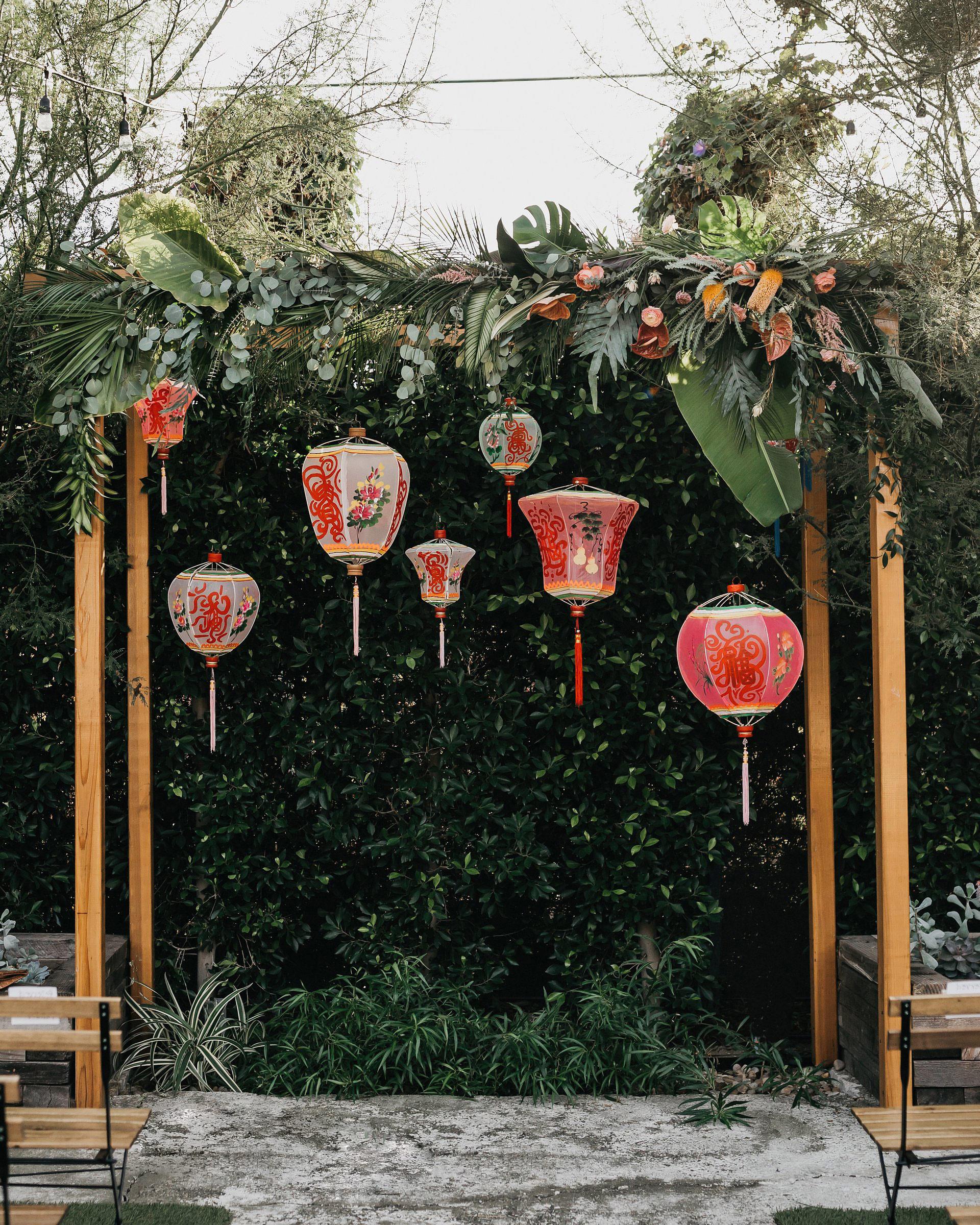 colleen pip wedding ceremony arch lanterns