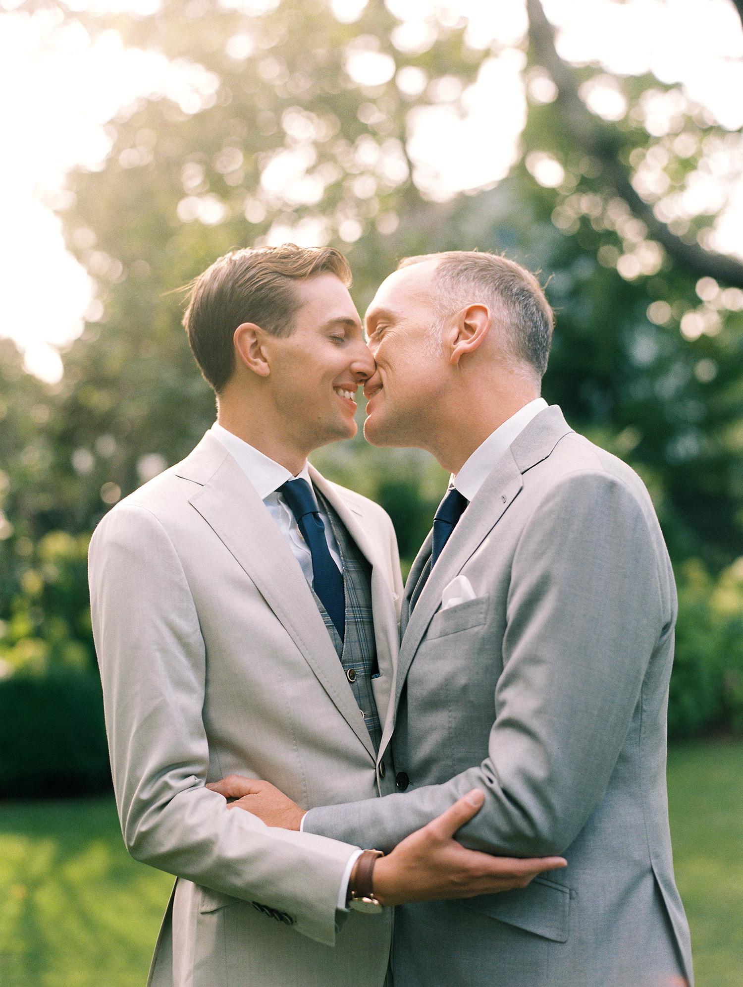 charles andrew wedding grooms outdoor kiss