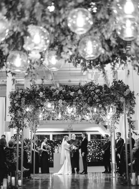 katie andre wedding ceremony flowers black white couple