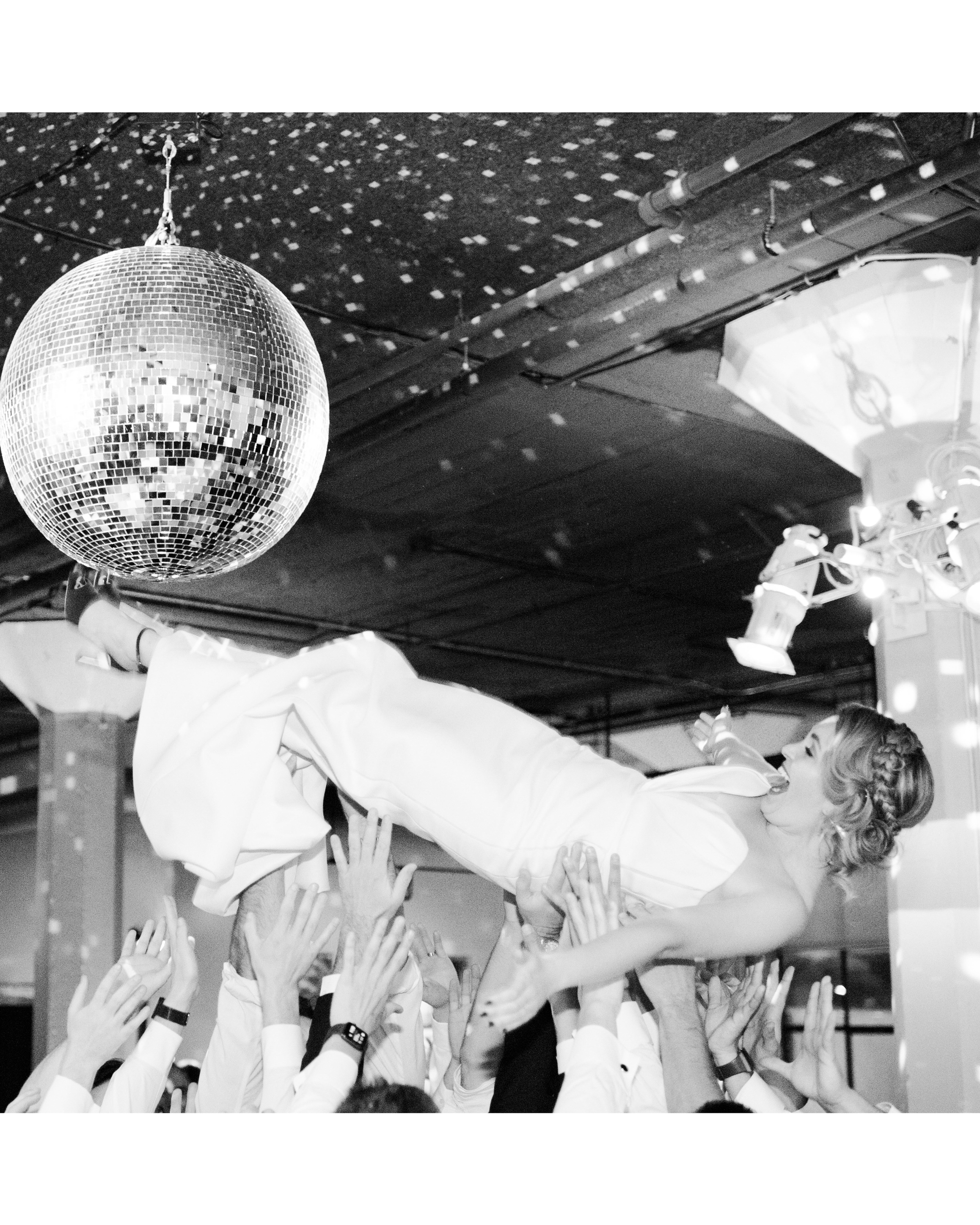 katie andre wedding bride crowd surf dance floor disco ball