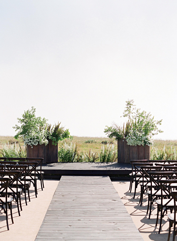 whitney zach wedding ceremony in field