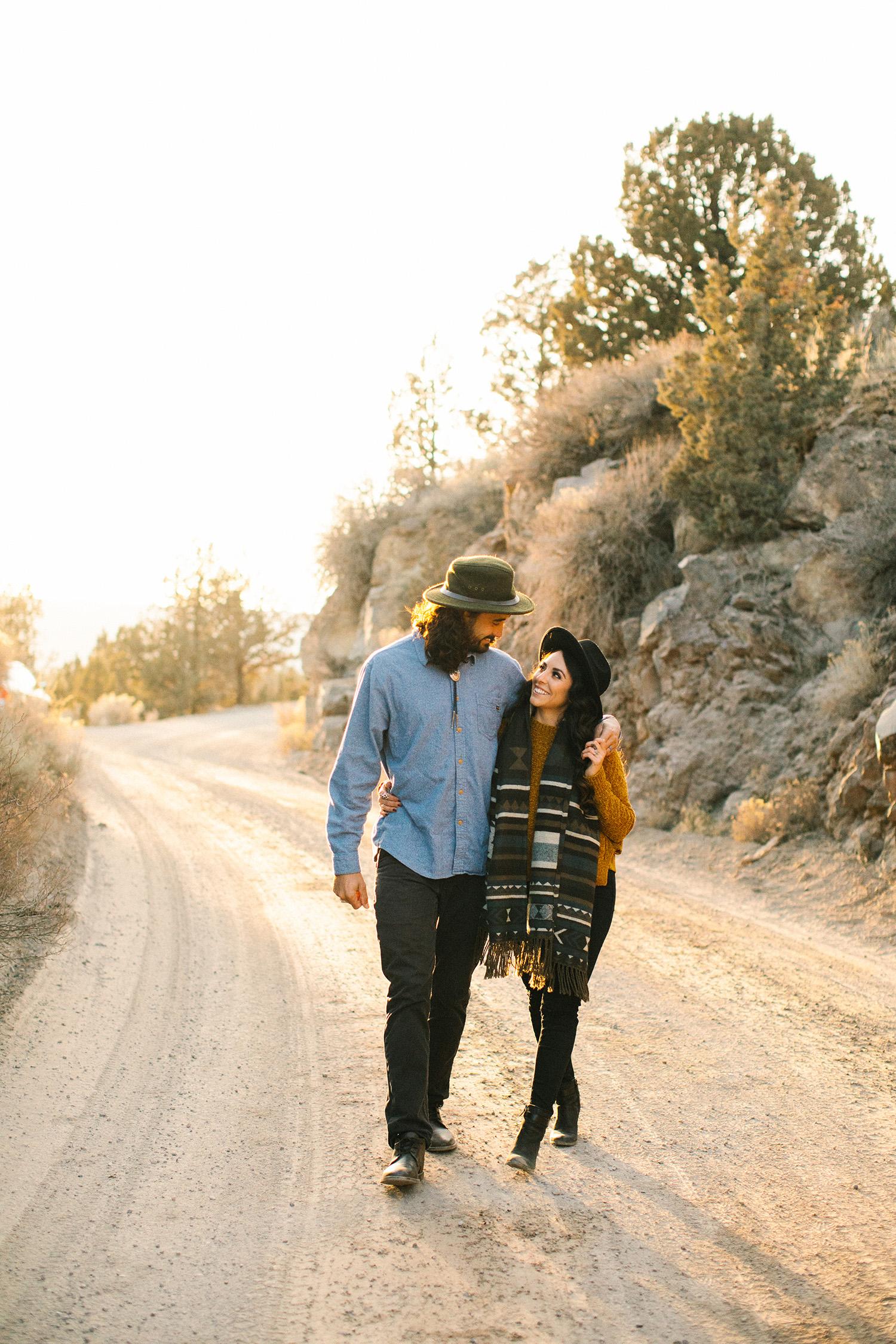 couple walking in desert outdoor engagement photos